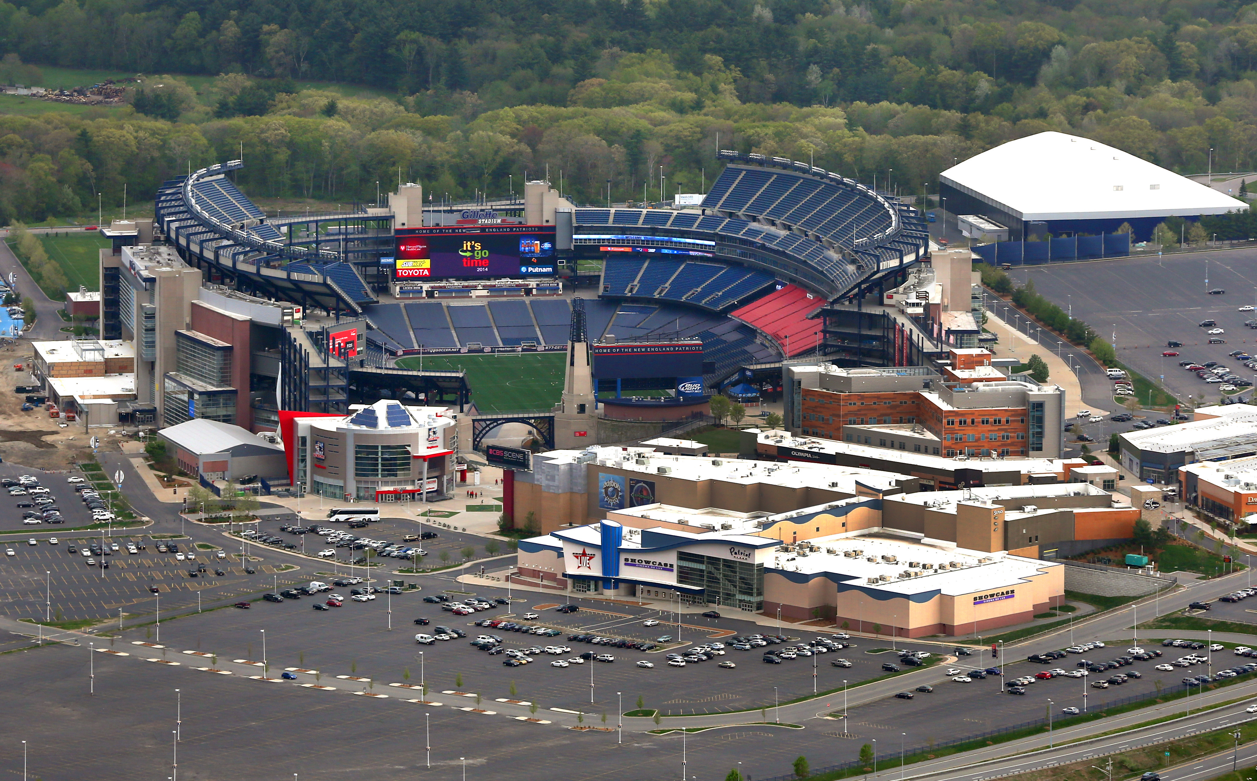 An aerial shot of a football stadium and the shopping complex next to it.