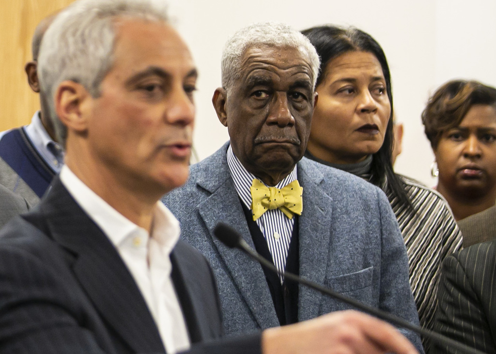 The Rev. Leon Finney listens as then-Mayor Rahm Emanuel speaks at a news conference in 2017.