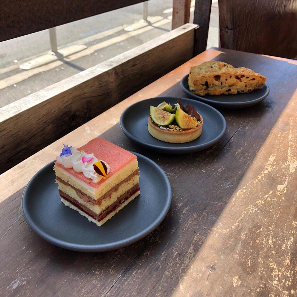 A Princess cake, fig tart and cocoa nib scone at Dandelion Chocolate's Valencia, California café.