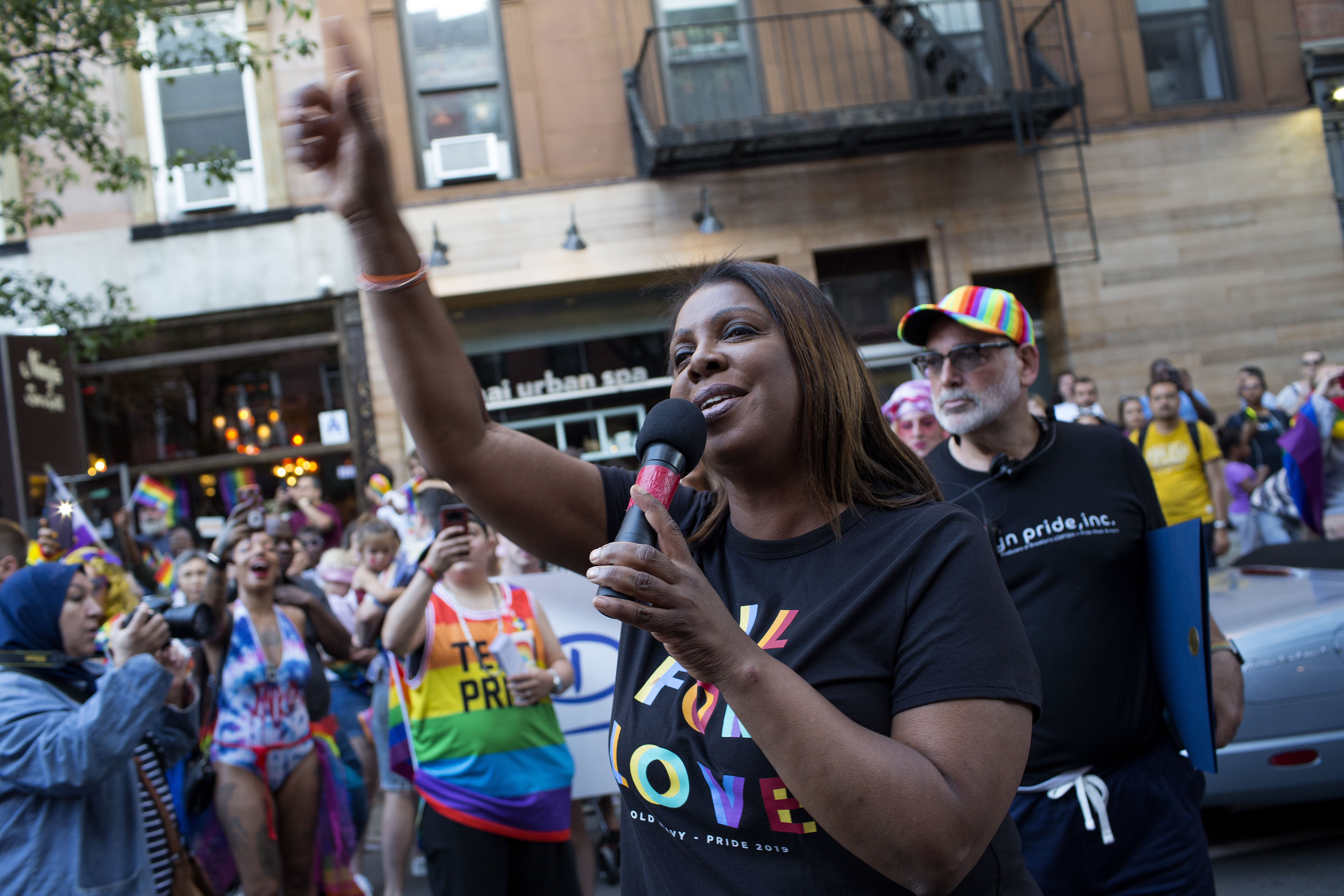 New York Attorney General Letitia James holding a microphone at Brooklyn Pride in June 2019.