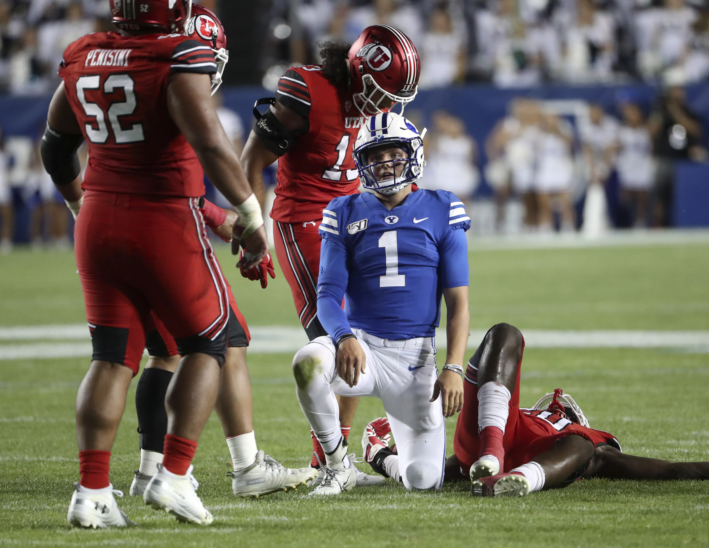Brigham Young Cougars quarterback Zach Wilson shrugs after a snap sailed over his head on a two-point conversion try during second half action in the University of Utah at BYU football game at LaVell Edwards Stadium in Provo on Thursday, Aug. 29, 2019.