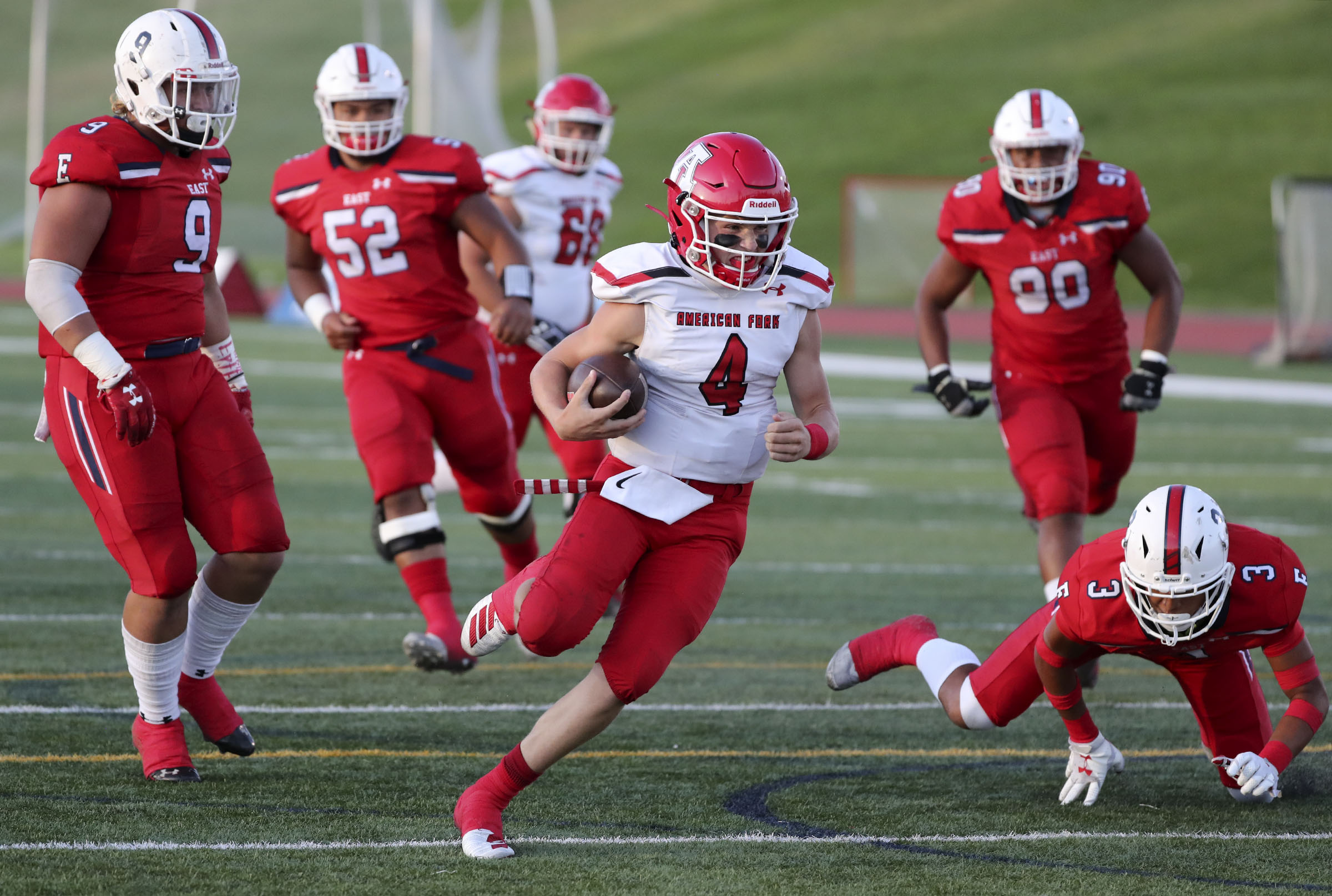 American Fork's Maddux Madsen runs with the ball during a football game against East High School at East High School in Salt Lake City on Friday, Sept. 6, 2019.