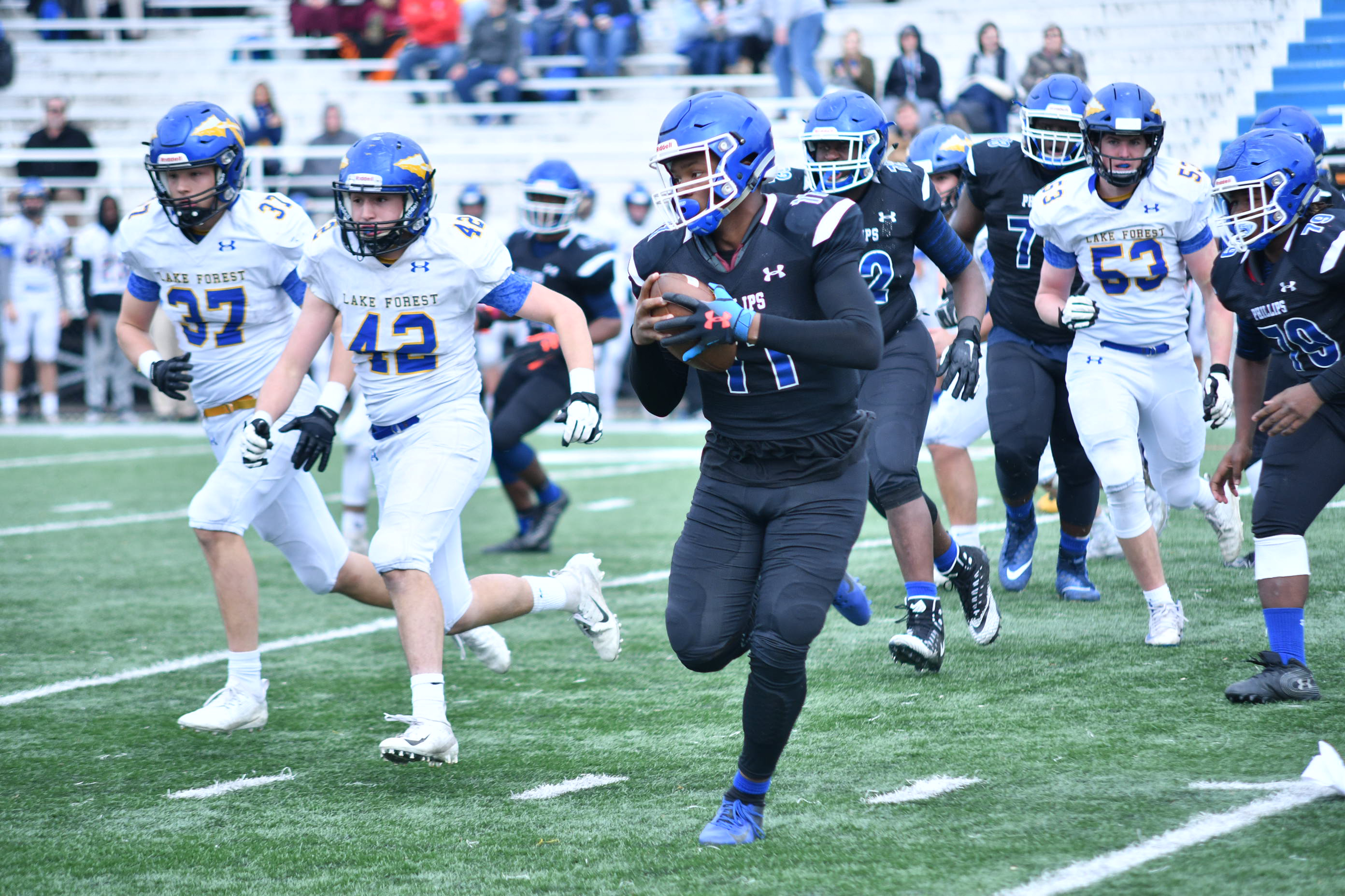 Phillips quarterback Terryon Thrower (11) gets chased out of the pocket.