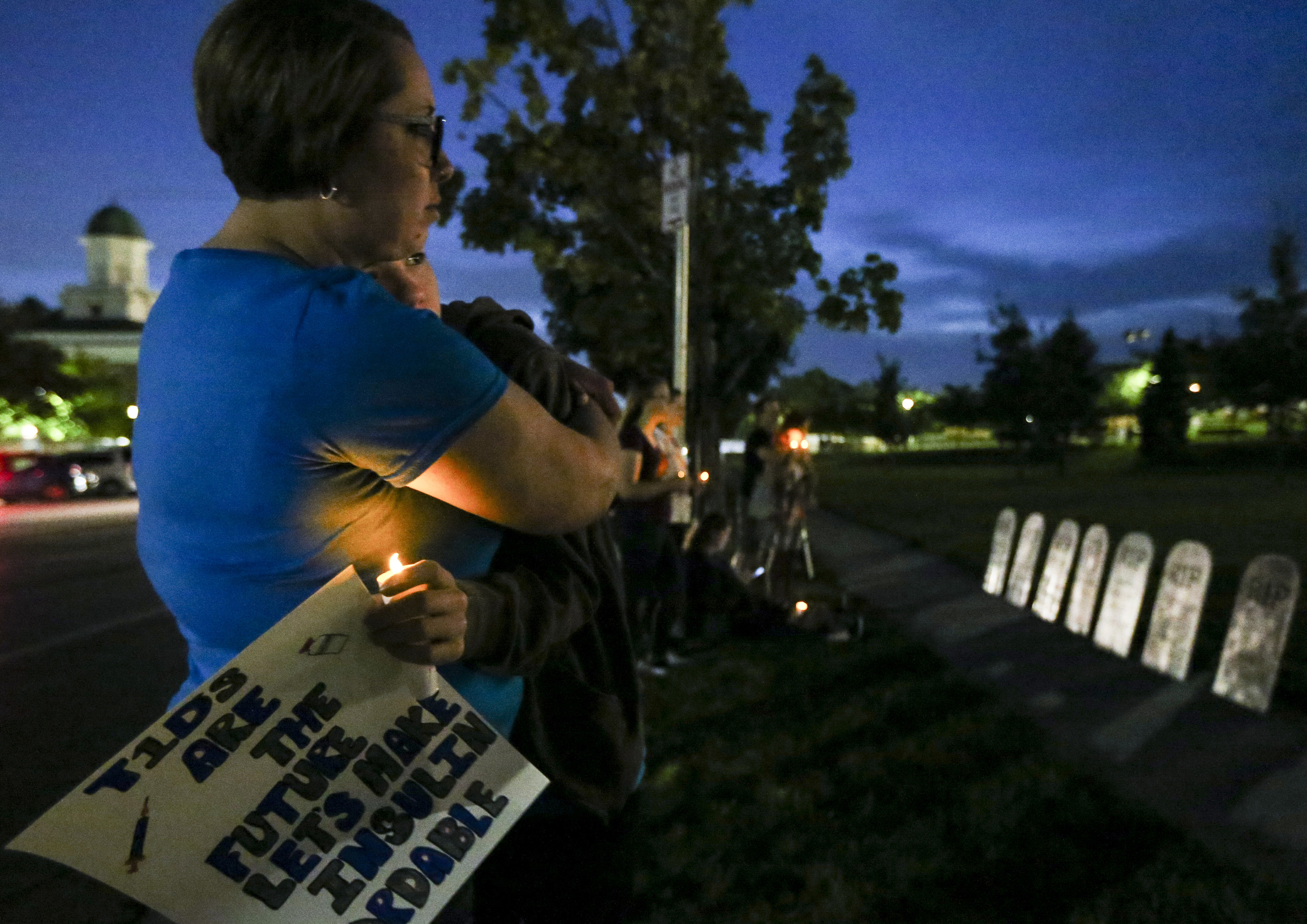 Stacie Mooney embraces Carson Mooney, 12, during a vigil held to remember the people who have been lost to Type 1 diabetes and to call for lower prices on insulin at the state Capitol in Salt Lake City on Saturday, Sept. 7, 2019.
