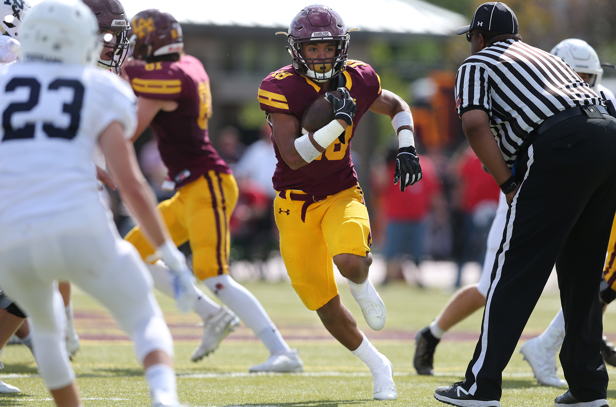 Loyola's Marco Maldonado (18) runs through an opening created by the Ramblers' offensive line.