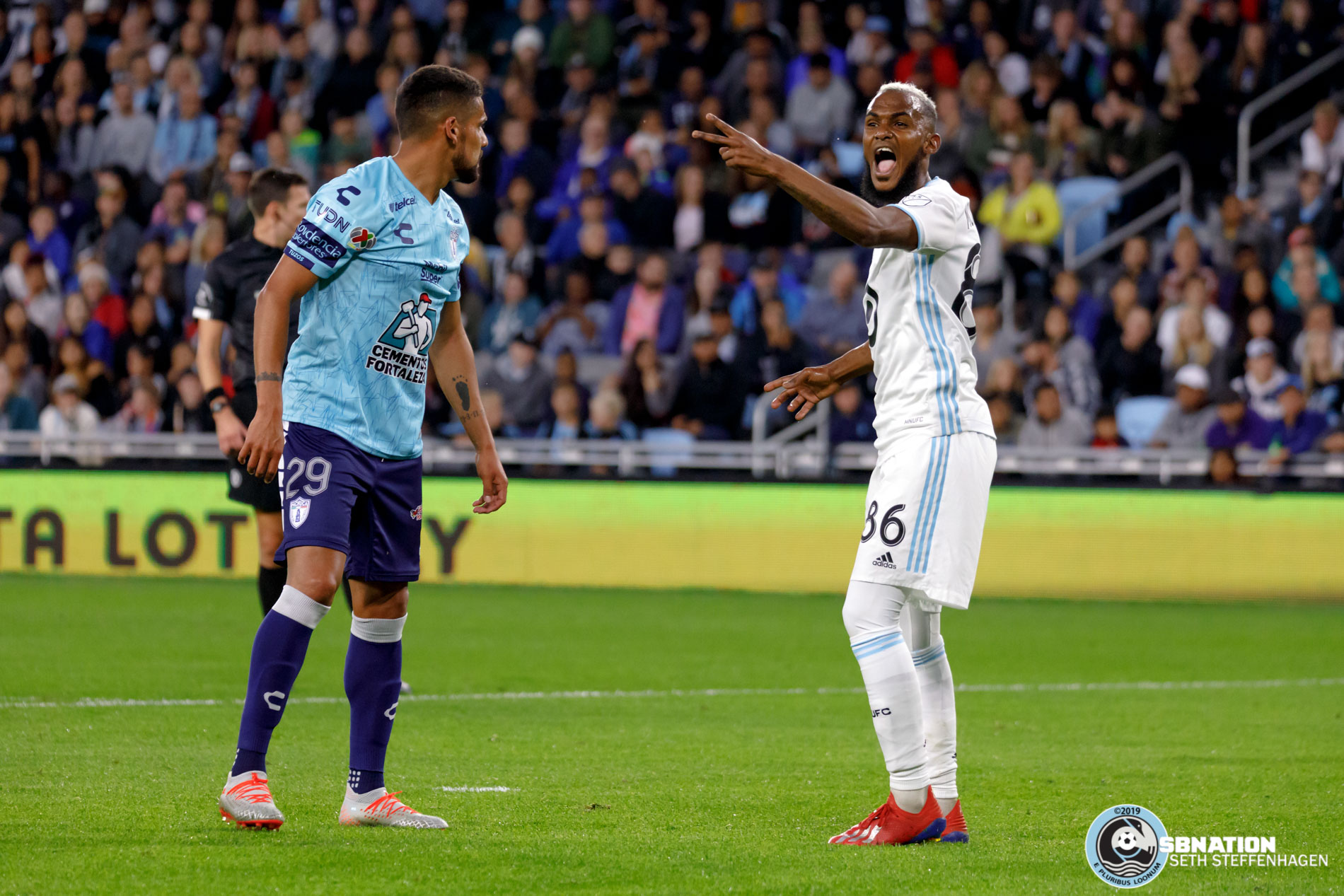 September 7, 2019 - Saint Paul, Minnesota, United States -  Minnesota United defender Wilfried Moimbé-Tahrat (86) reacts to pushing and shoving from Pachuca forward Franco Jara (29) during an international friendly at Allianz Field.