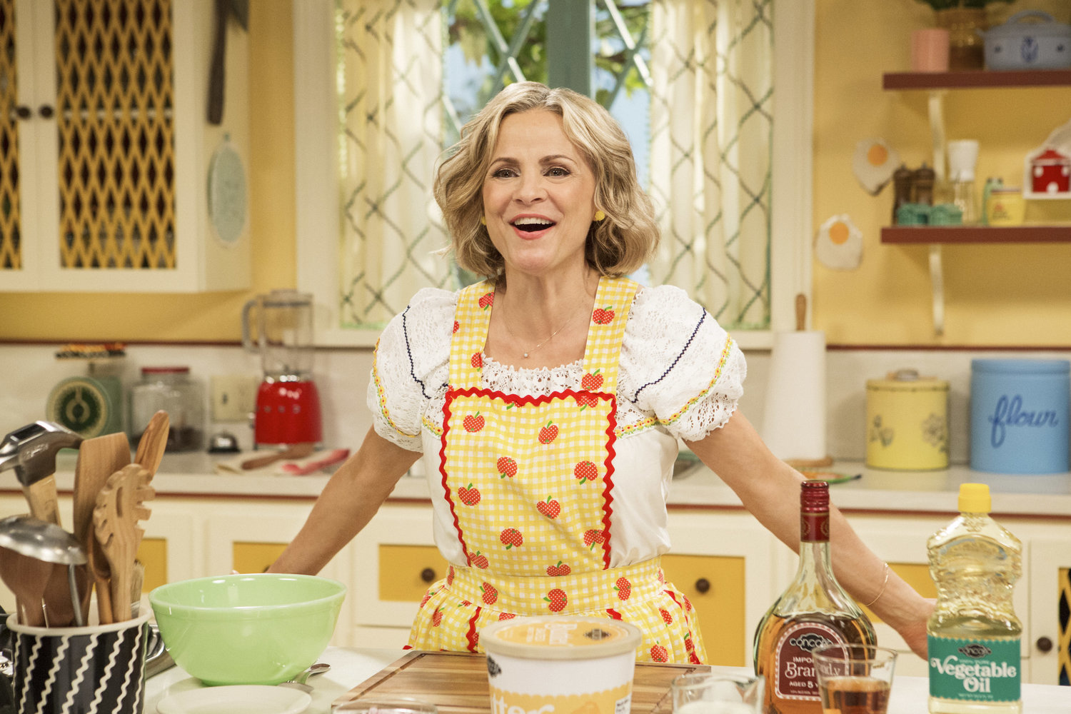 """Amy Sedaris stands in the kitchen during season one of """"At Home with Amy Sedaris"""" on TruTV."""