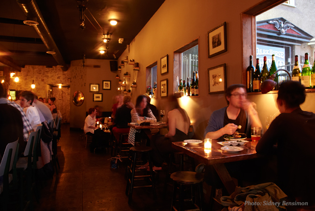 A dimly lit dining room at BarCovell.