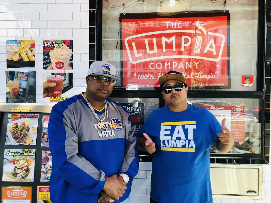 A photo of rapper E-40 and food entrepreneur Alex Retodo wearing a shirt that says Eat Lumpia