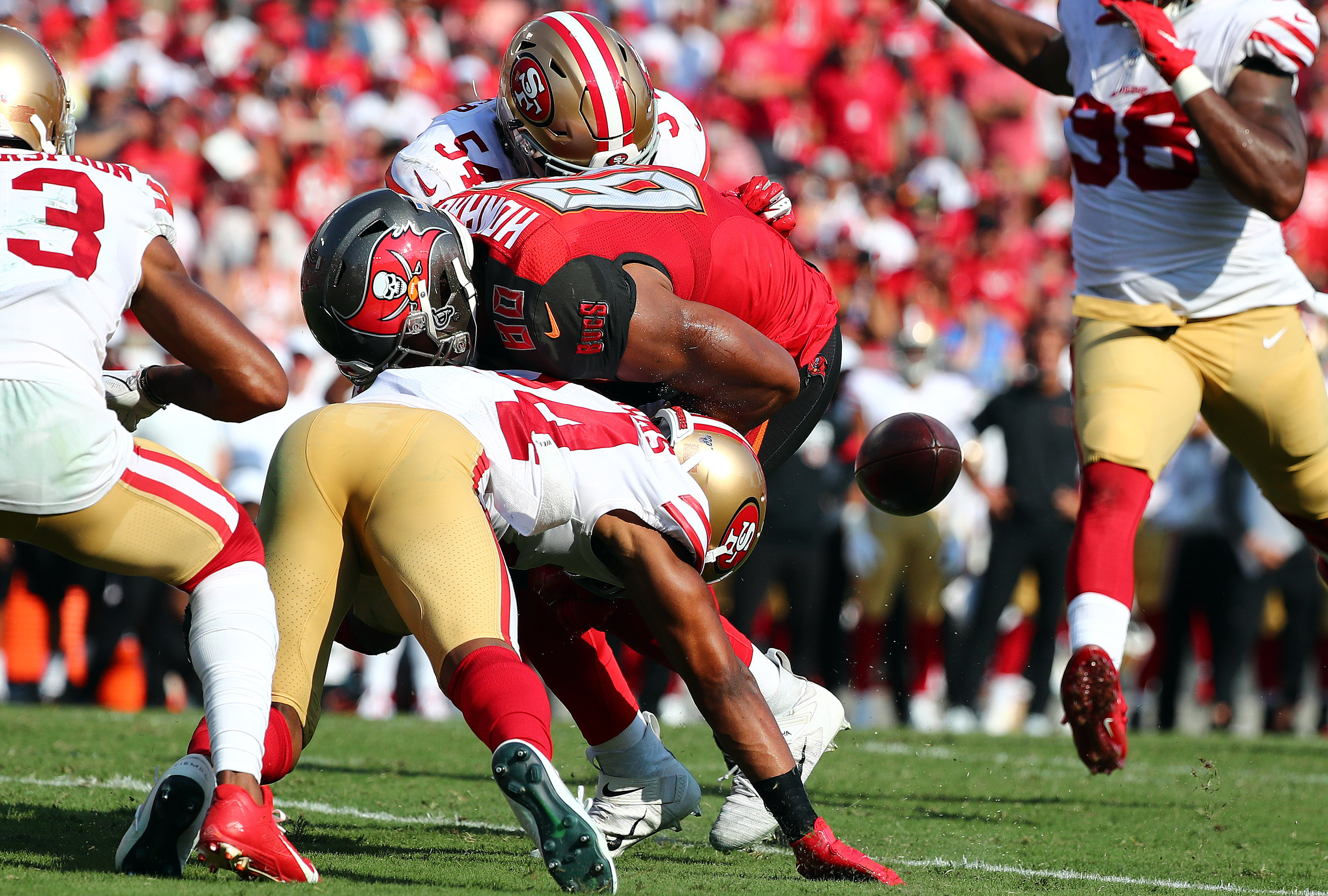 Tampa Bay Buccaneers tight end O.J. Howard fumbles the ball as San Francisco 49ers defensive back K'Waun Williams defends during the first half at Raymond James Stadium.