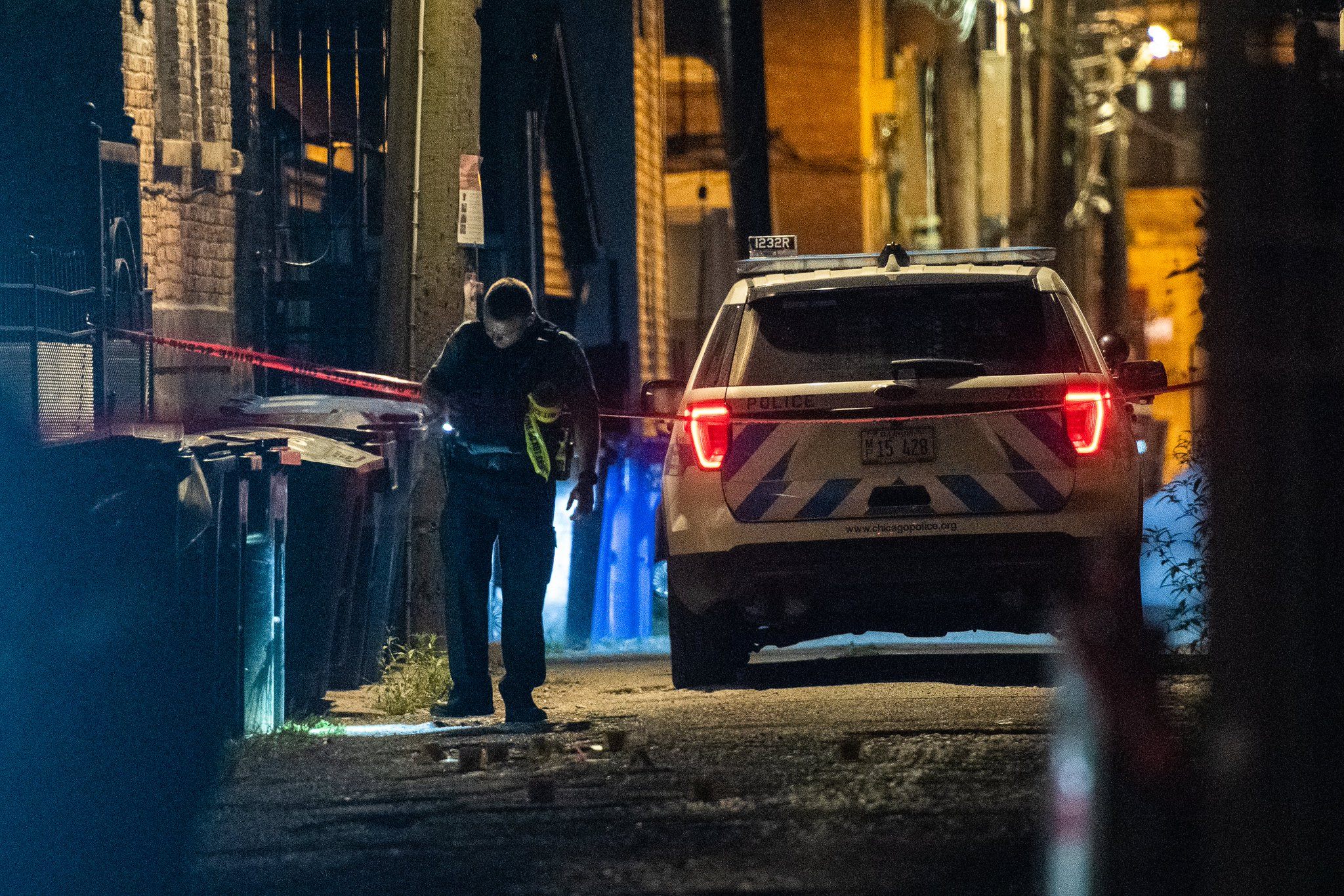 Chicago police investigate the scene where a man was found shot to death in an alley in the 1600 block of South Loomis Street.