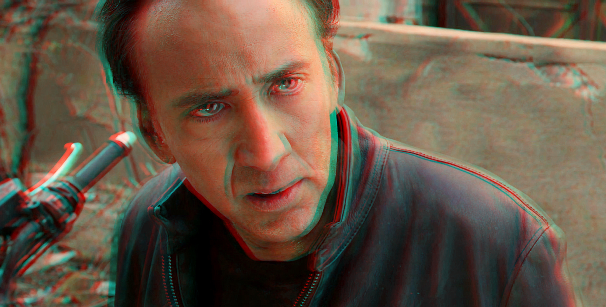 a close up of nicolas cage sitting on a motorcycle, looking stunned in ghost rider spirit of vengeance with 3D effect