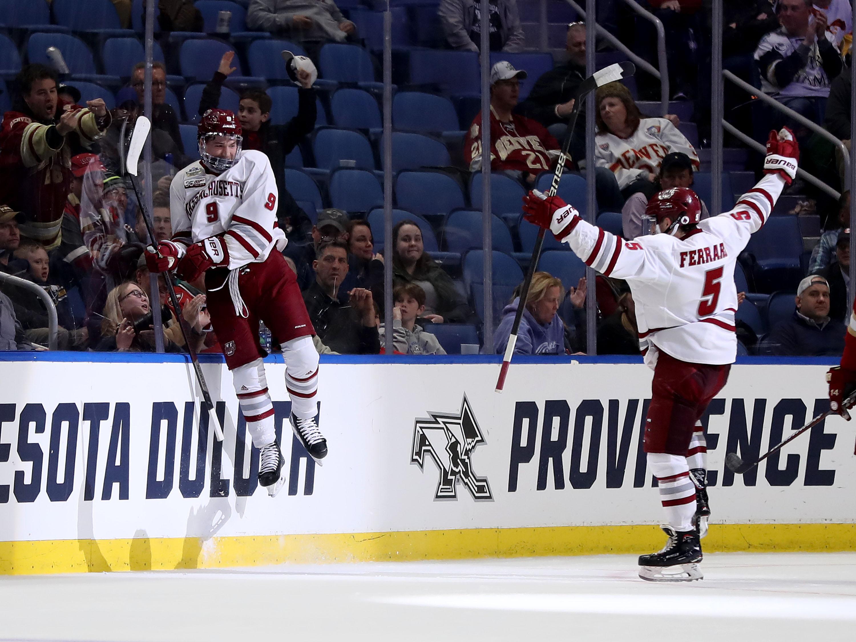 John Leonard of the Massachusetts Minutemen celebrates his goal with Mario Ferraro during the semifinals of the NCAA Men's Frozen Four at KeyBank Center on April 11, 2019 in Buffalo, New York.