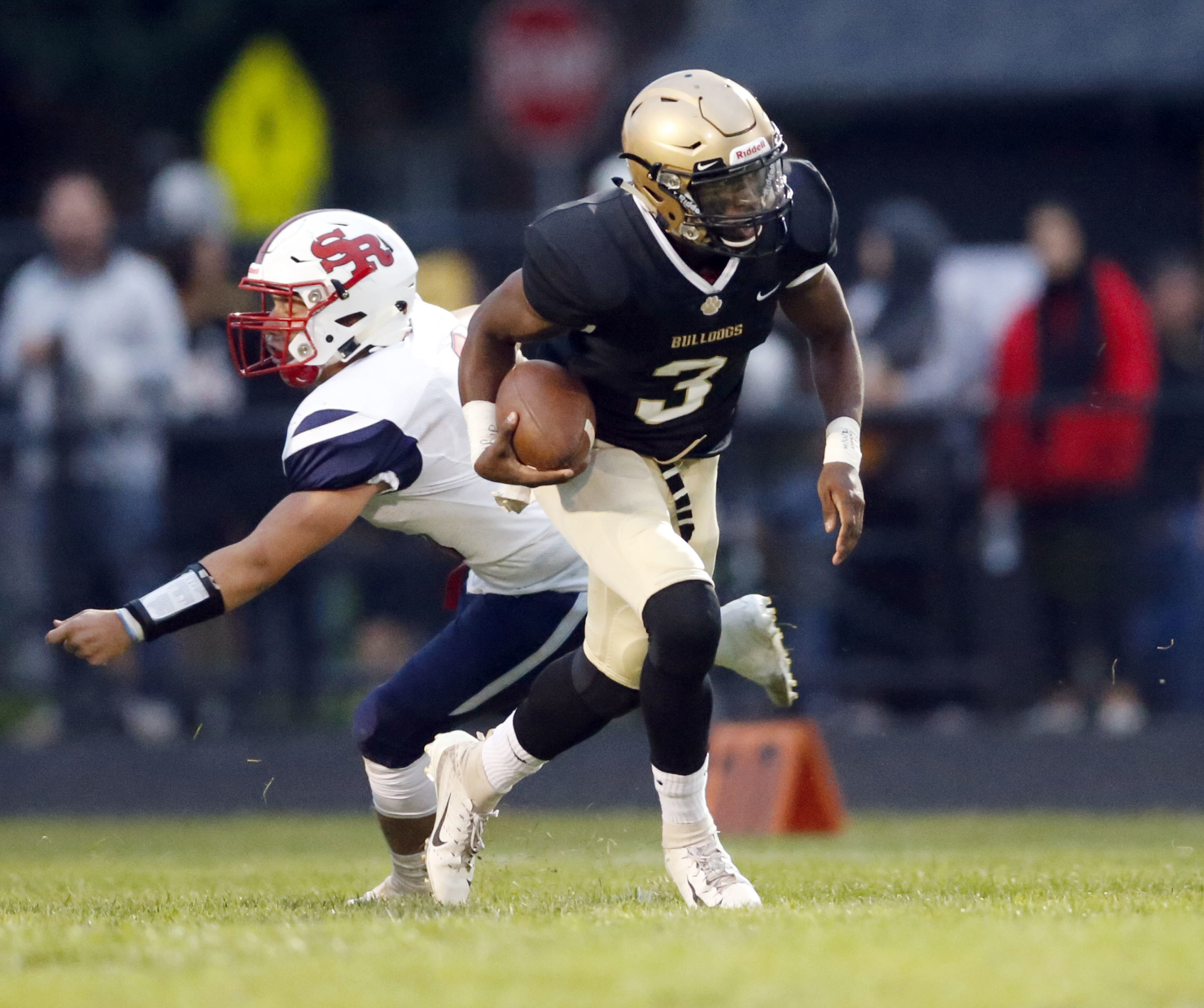 Richards' Javon Robinson (3) is flushed from the pocket by St. Rita.