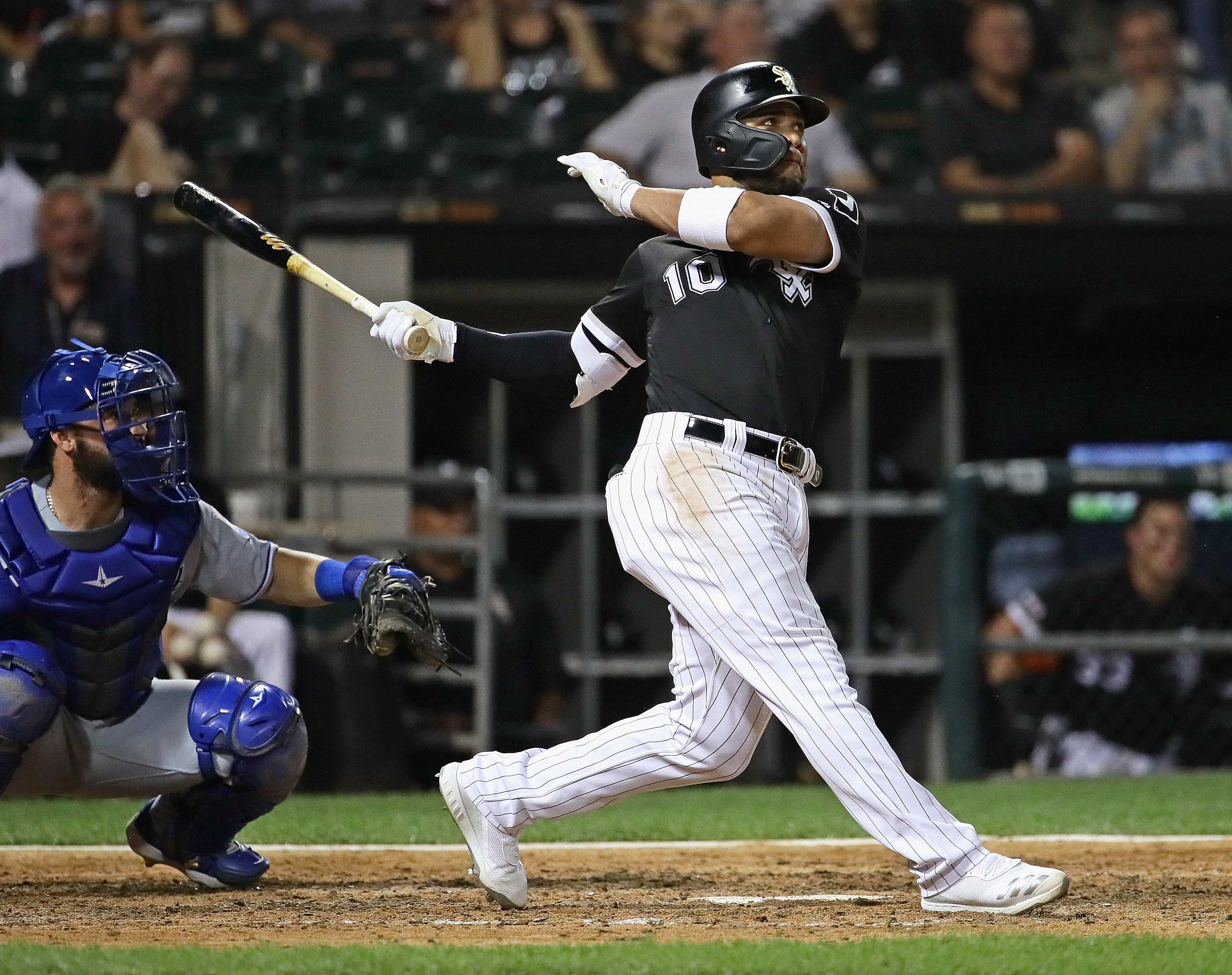 Yoan Moncada #10 of the Chicago White Sox hits a two run home run in the 7th inning against the Kansas City Royals at Guaranteed Rate Field on September 10, 2019 in Chicago, Illinois.