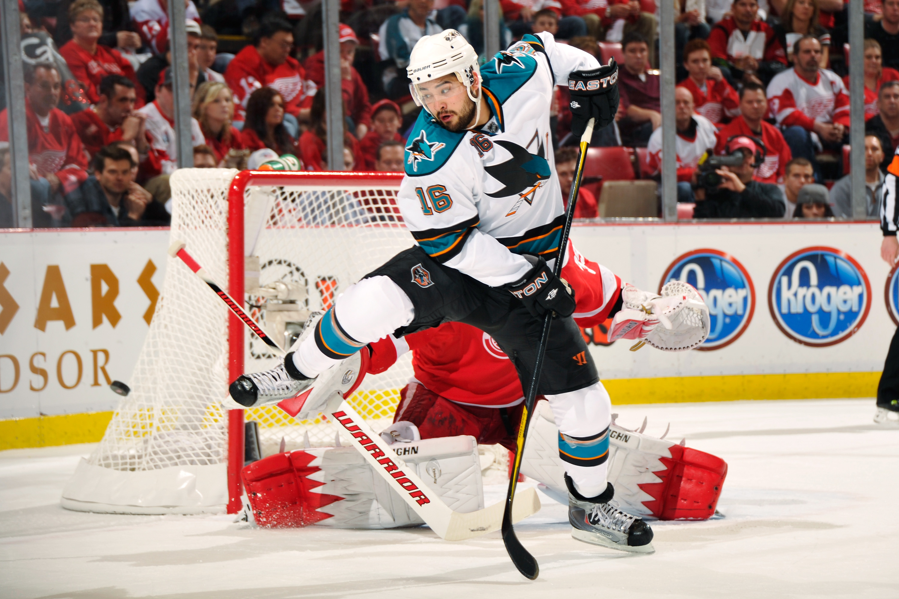 Devin Setoguchi of the San Jose Sharks attempts to screen goaltender Jimmy Howard of the Detroit Red Wings in the first period in Game 3 of the Western Conference Semifinals during the 2011 NHL Stanley Cup Playoffs on May 4, 2011