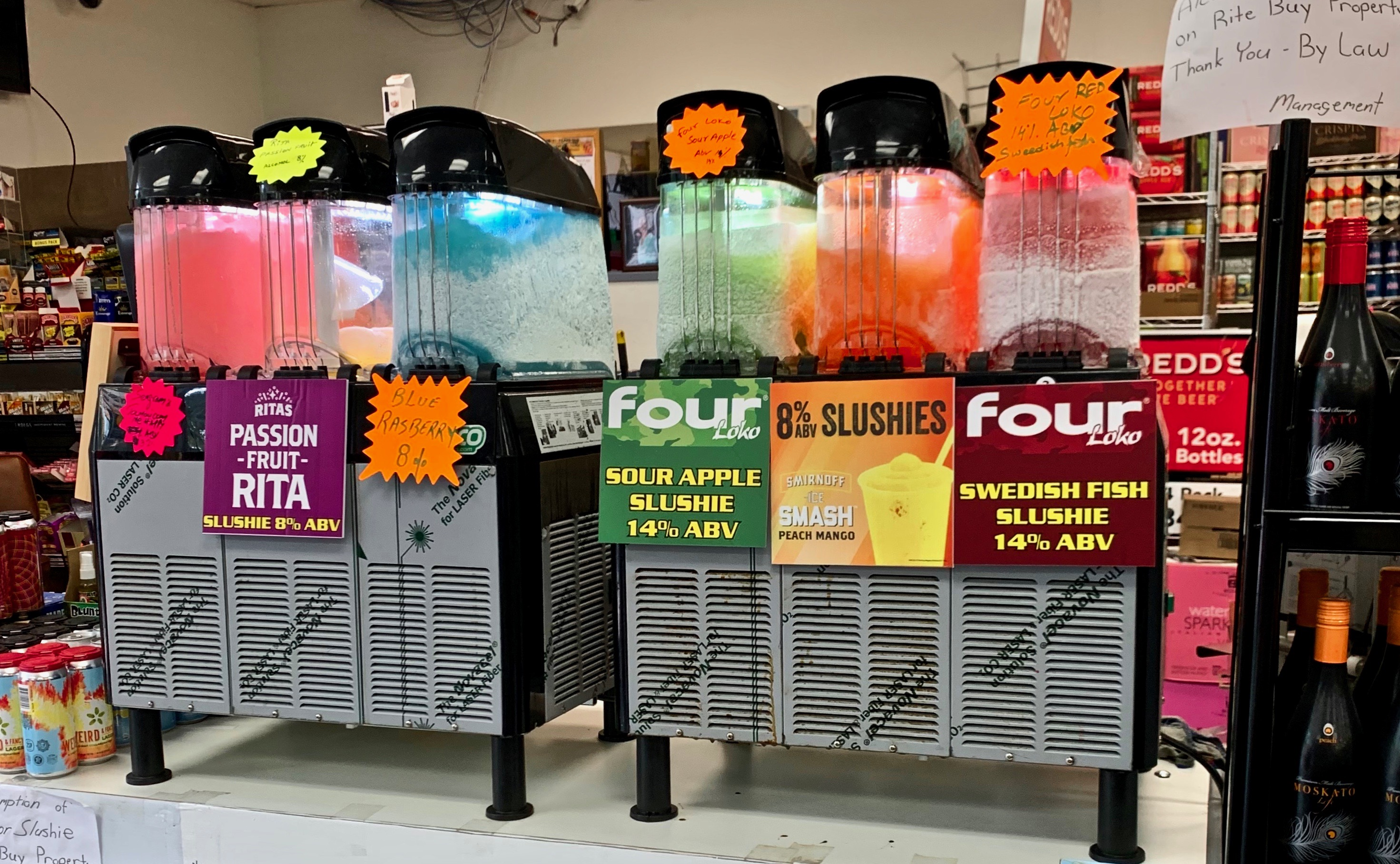 slushie machies with brightly colored drinks inside