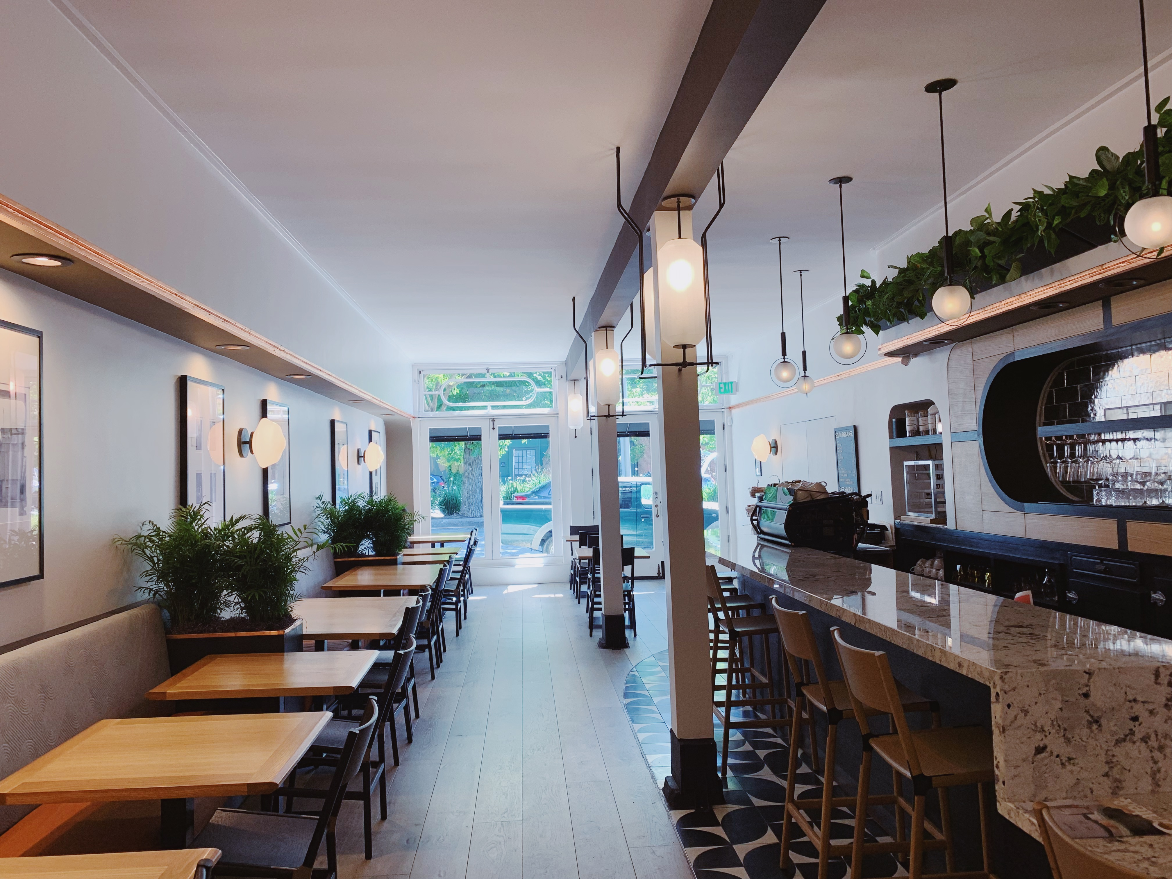 Inside the new South Park Cafe, where tables and a bar are visible