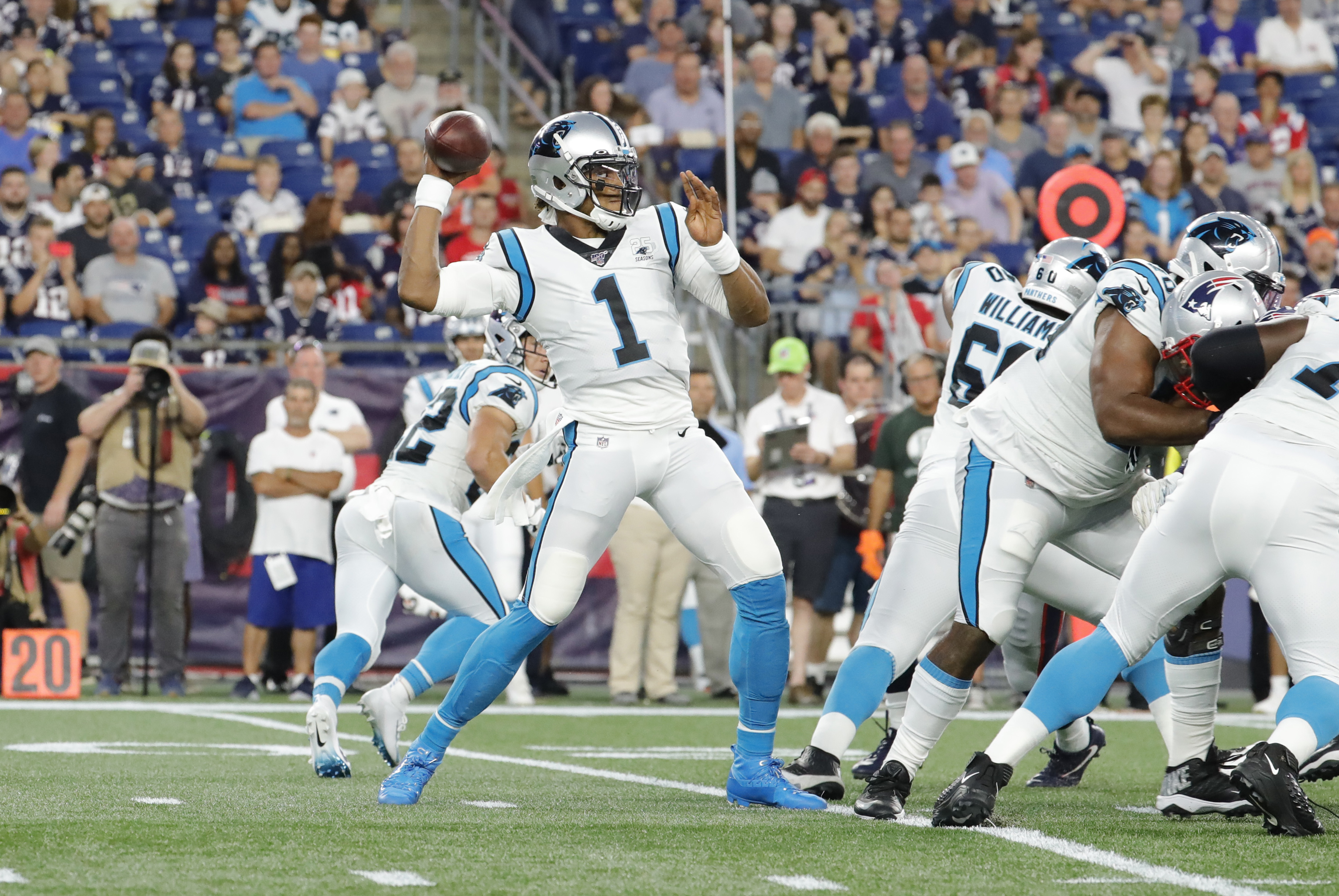 Carolina Panthers quarterback Cam Newton passes the ball during a preseason game between the New England Patriots and the Carolina Panthers on August 22, 2019, at Gillette Stadium in Foxborough, Massachusetts.