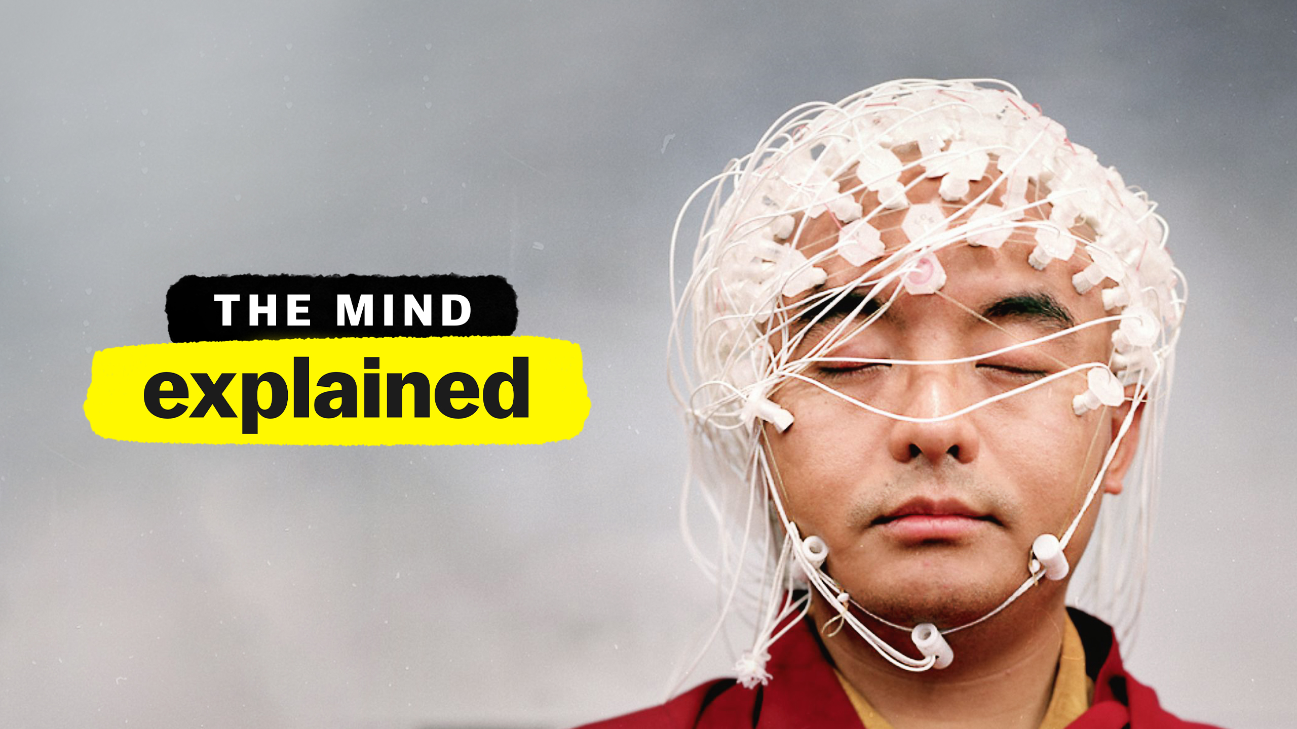 "Thumbnail for ""The Mind, Explained"" series showing a monk wearing EEG sensors"