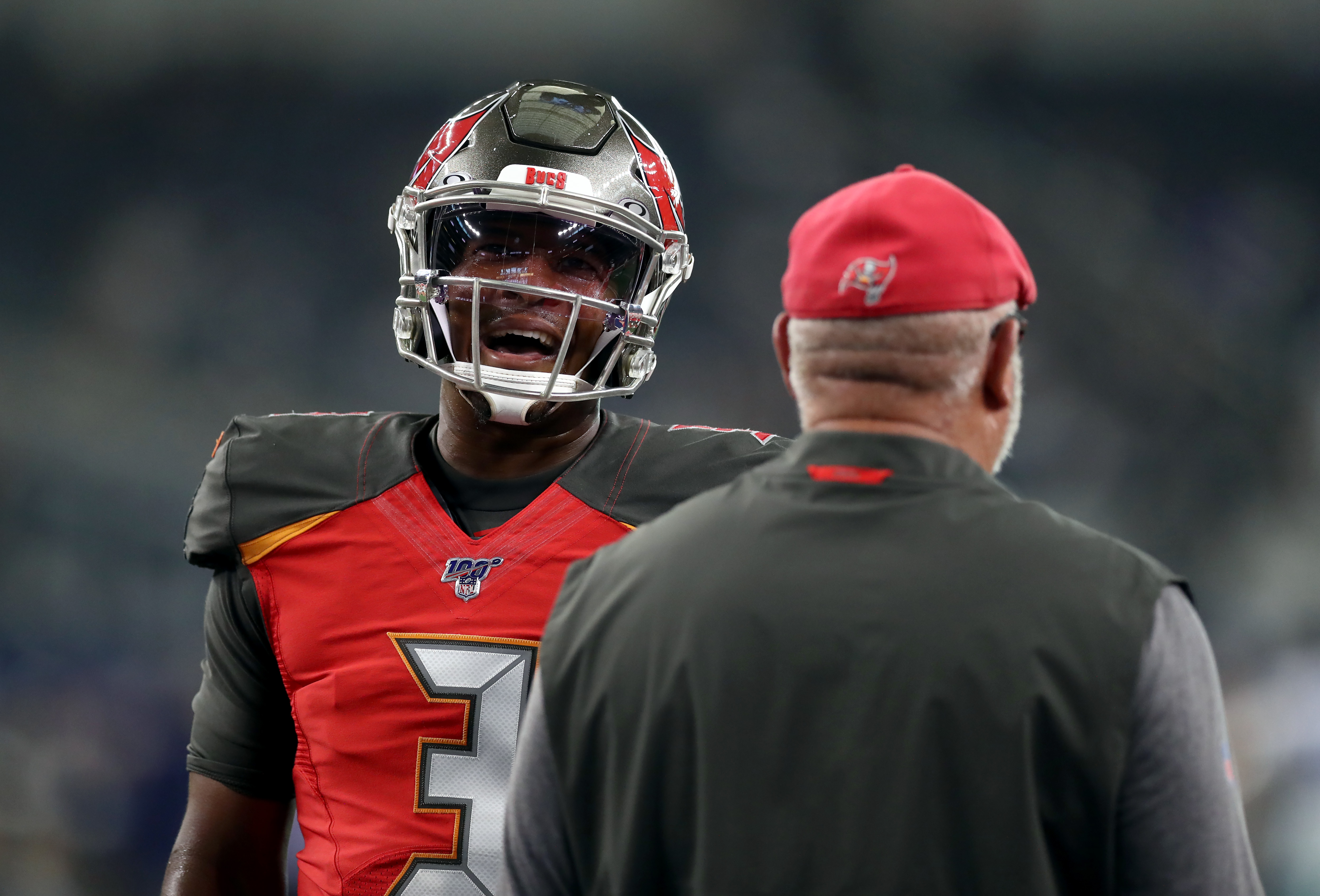Tampa Bay Buccaneers quarterback Jameis Winston talks with head coach Bruce Arians before a NFL preseason game at AT&T Stadium on August 29, 2019 in Arlington, Texas.