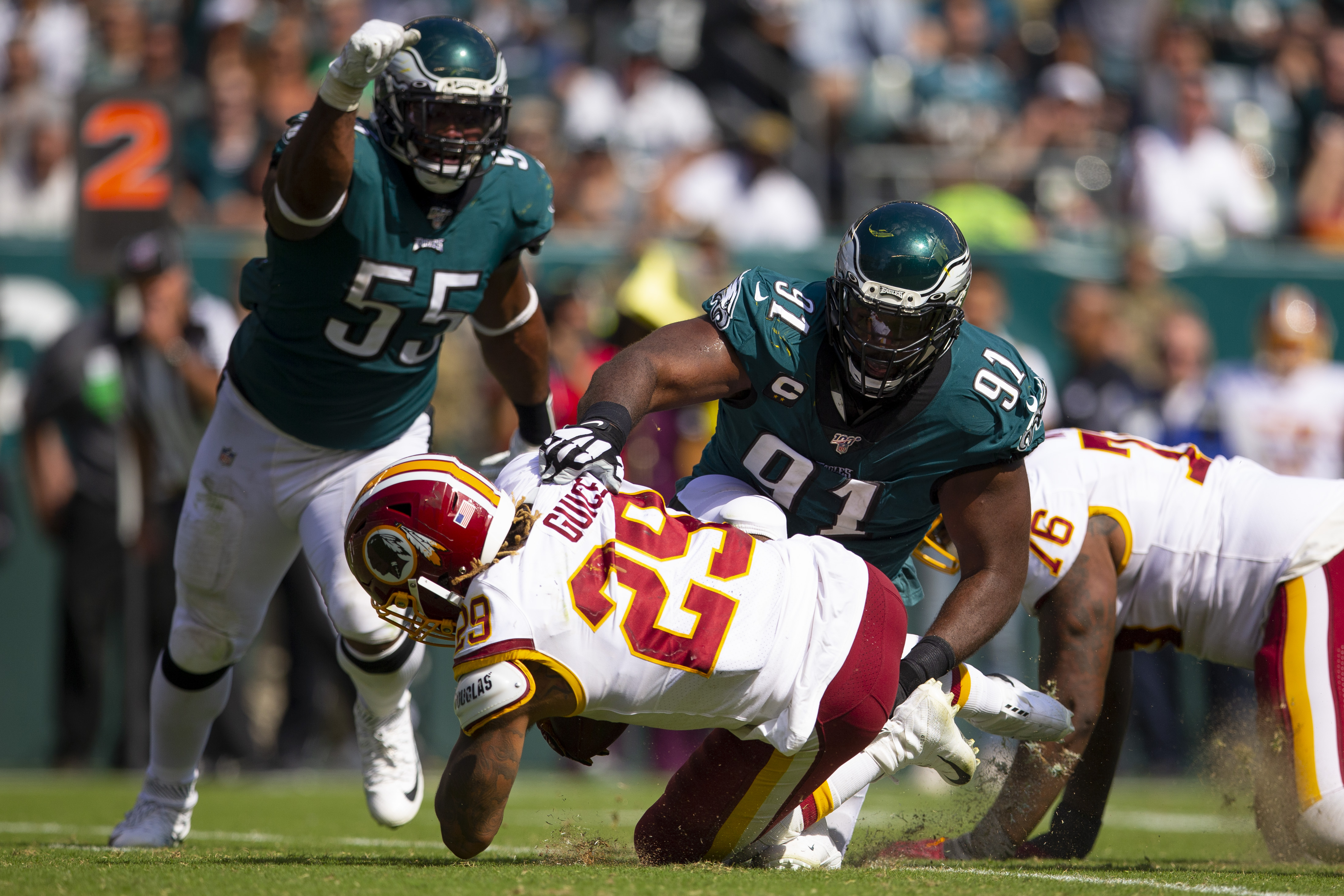 Fletcher Cox of the Philadelphia Eagles tackles Derrius Guice of the Washington NFL team at Lincoln Financial Field on September 8, 2019 in Philadelphia, Pennsylvania.