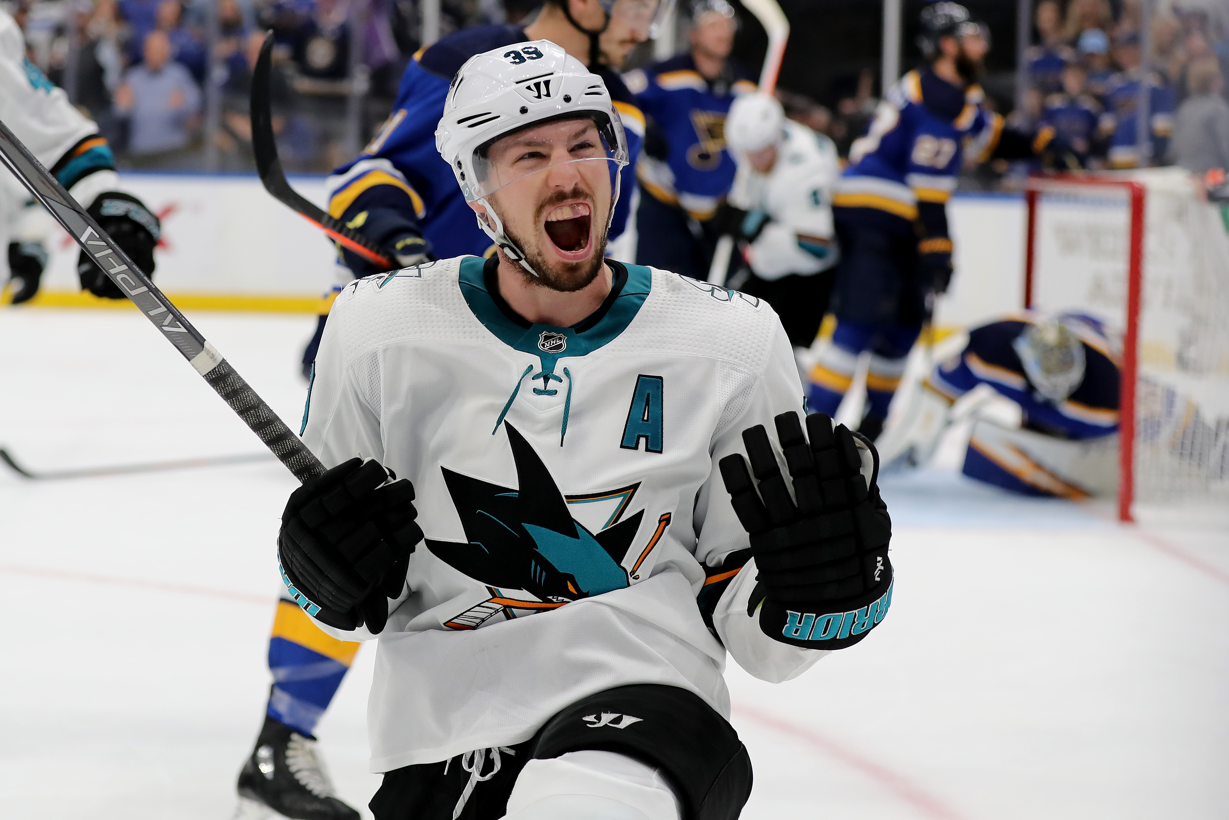 Logan Couture of the San Jose Sharks celebrates after scoring a goal on Jordan Binnington of the St. Louis Blues during the third period in Game 3 of the Western Conference Final during the 2019 NHL Stanley Cup Playoffs at Enterprise Center on May 15, 201