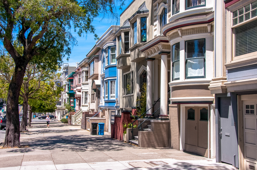 Colorful San Francisco Victorian apartment buildings in a row.