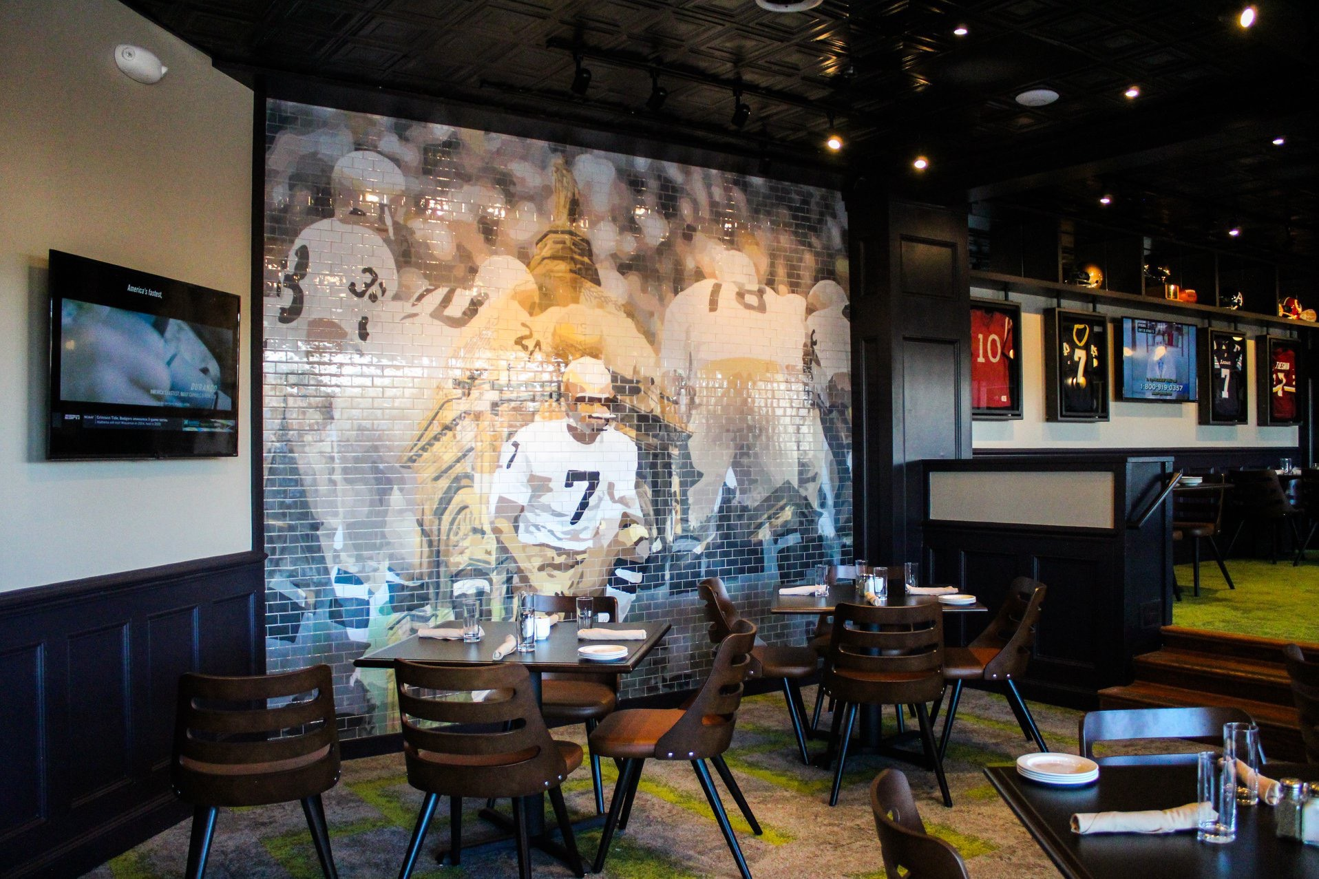 A slick mural of Joe Theismann from his time at Notre Dame.