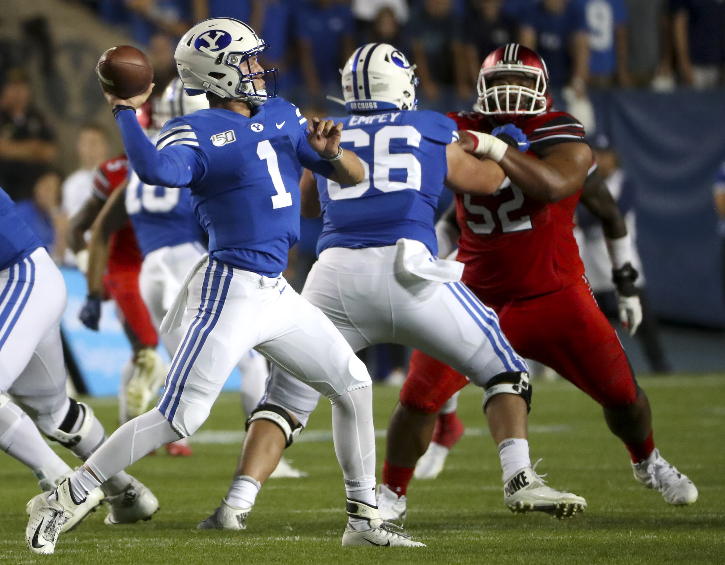 BYU quarterback Zach Wilson fires a pass during the Utah-BYU football game at LaVell Edwards Stadium in Provo on Thursday, Aug. 29, 2019.