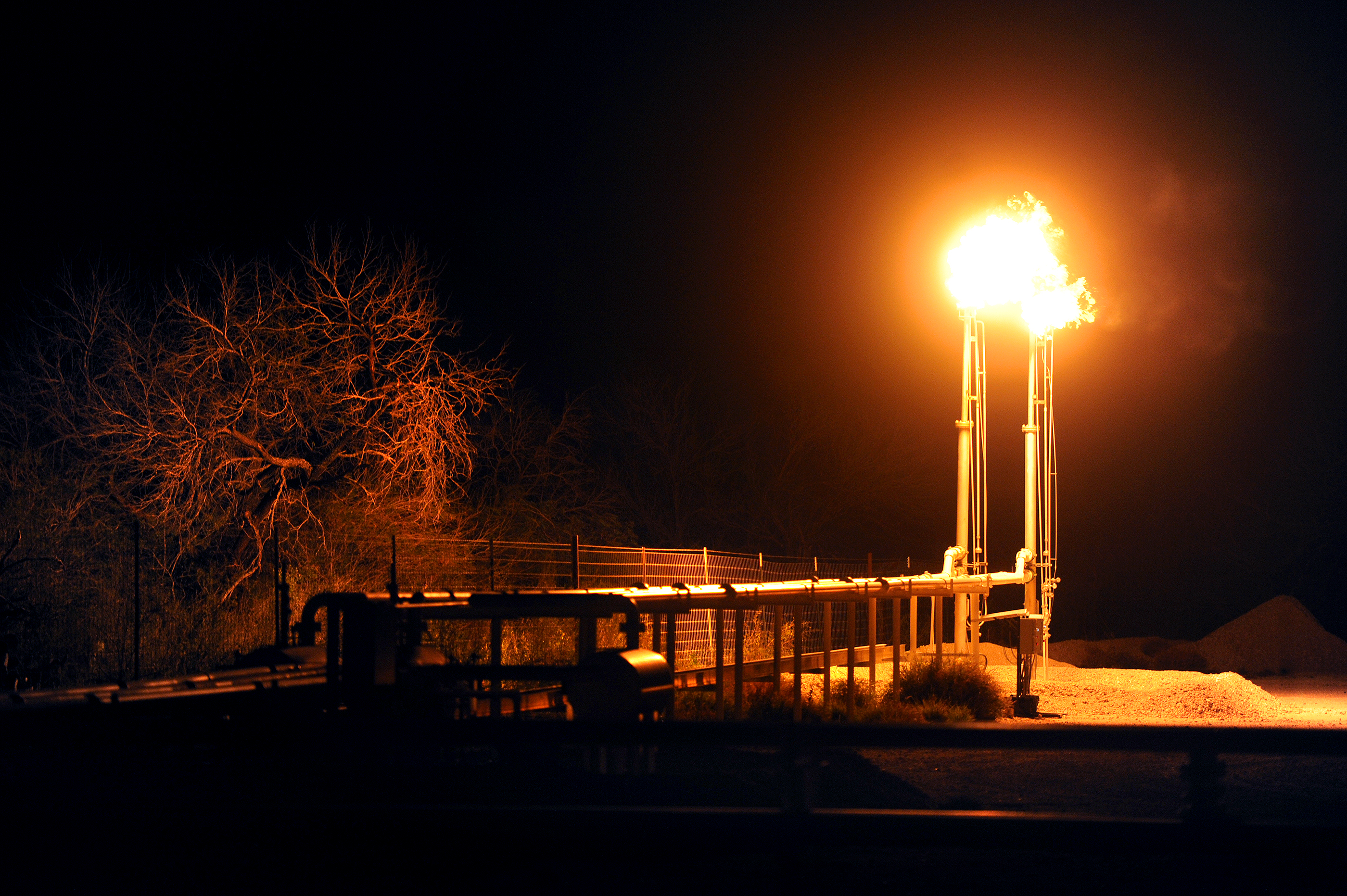 Flames light up the landscape at a fracking operation near Tilden, Texas.