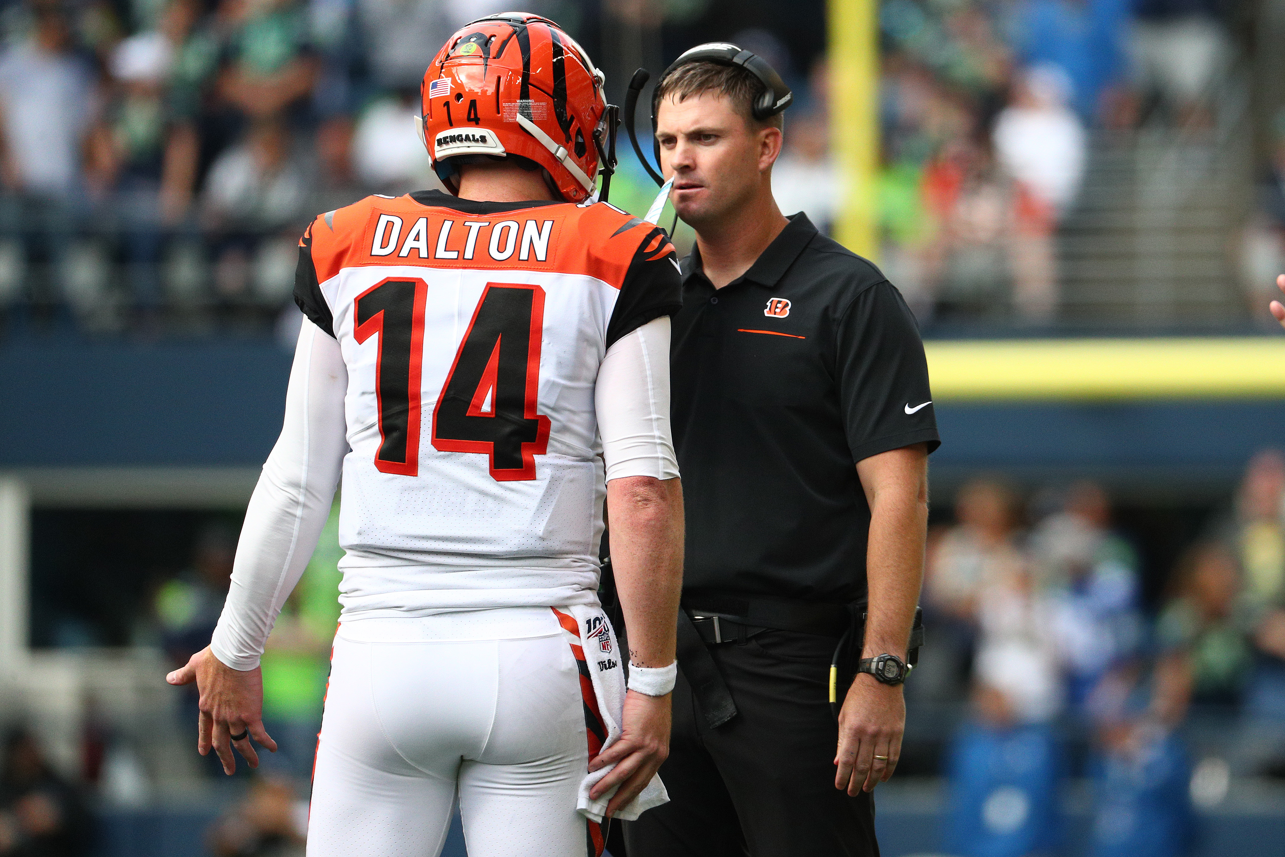 Quarterback Andy Dalton and head coach Zac Taylor of the Cincinnati Bengals have a conversation in the fourth quarter against the Seattle Seahawks during their game at CenturyLink Field on September 08, 2019 in Seattle, Washington.
