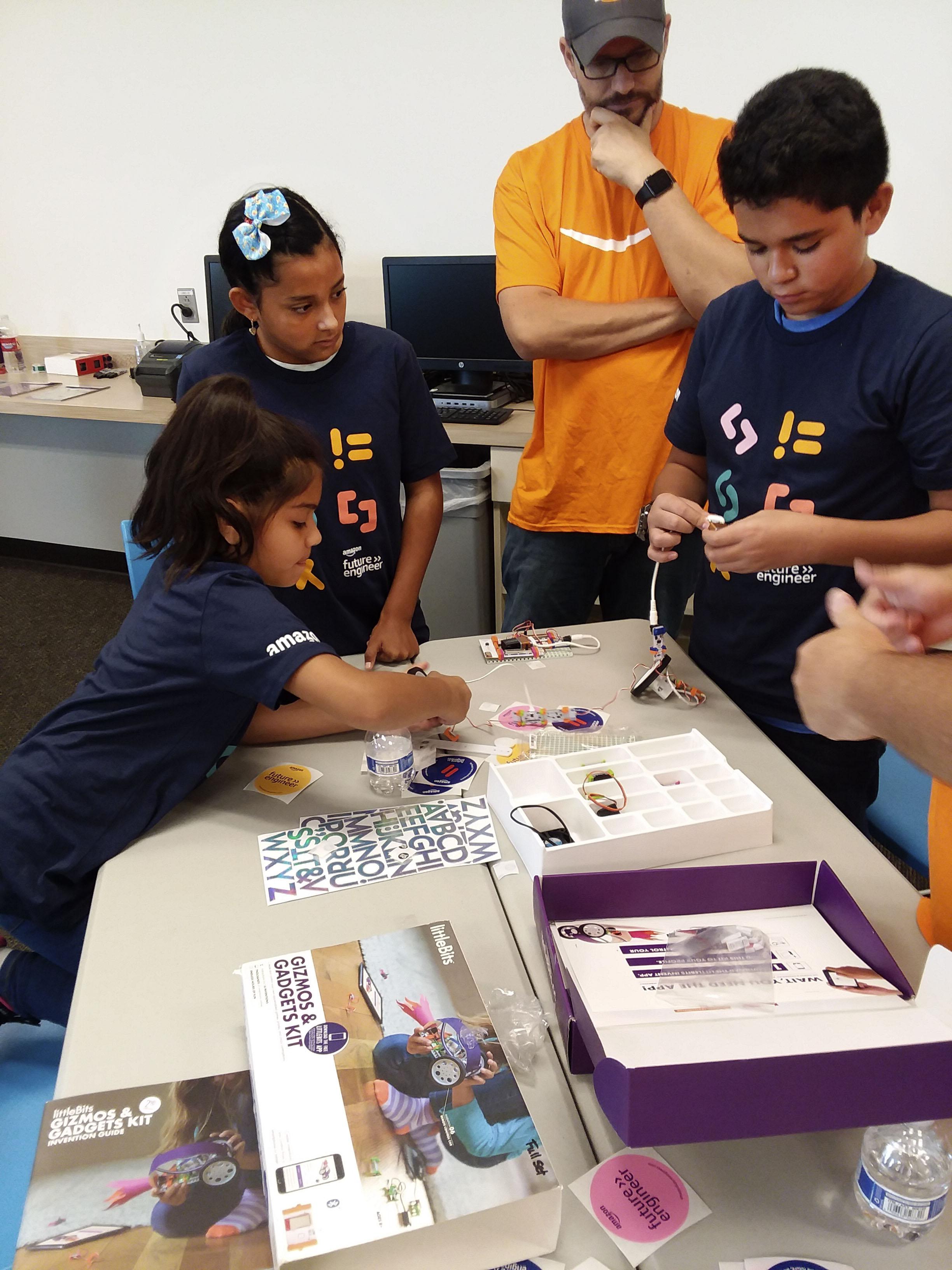 Woodrow Wilson Elementary School students embark on a robot-building mission at Amazon's Salt Lake City fulfillment center on Thursday, Sept. 12, 2019.
