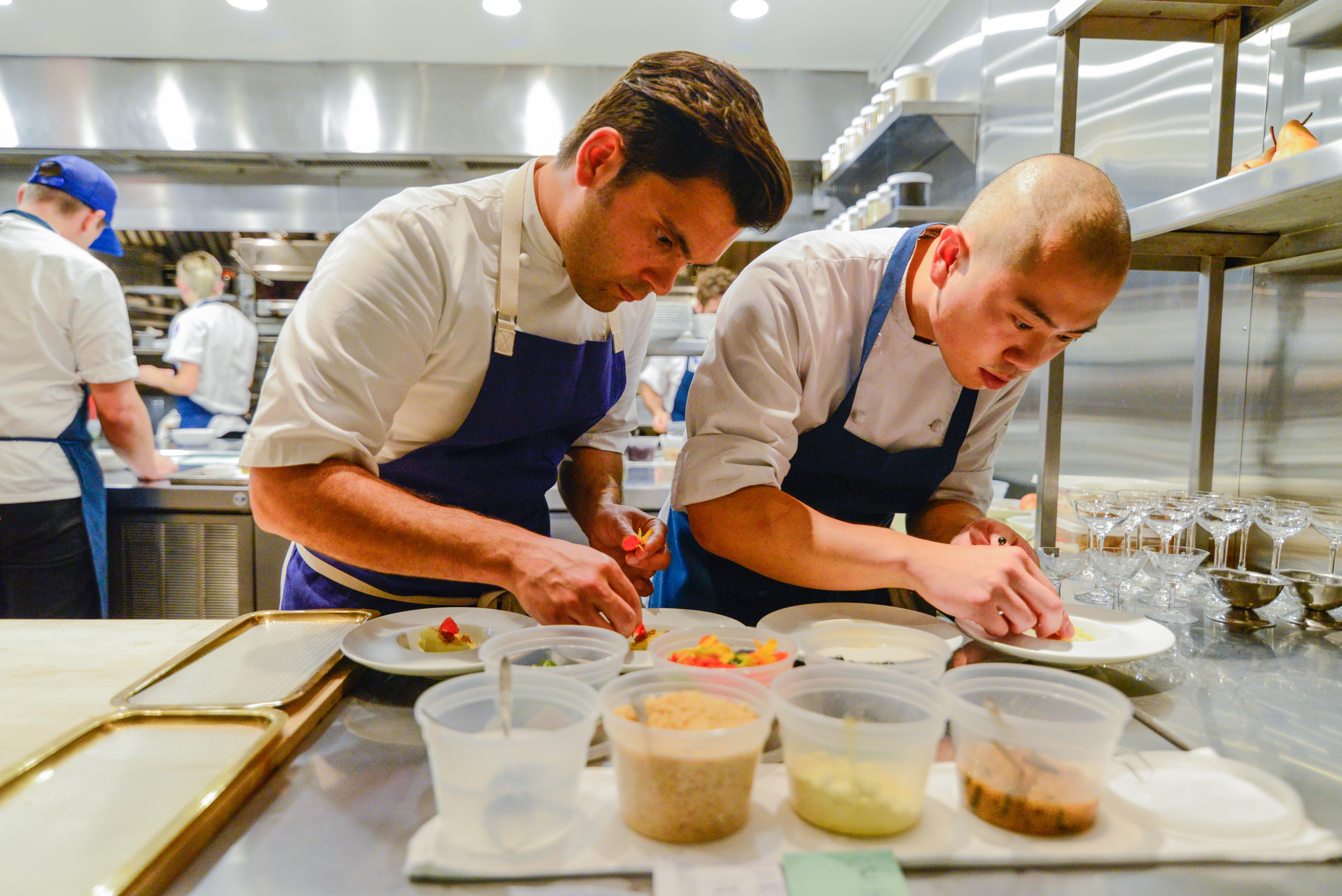 Chefs at Komi work in the kitchen.