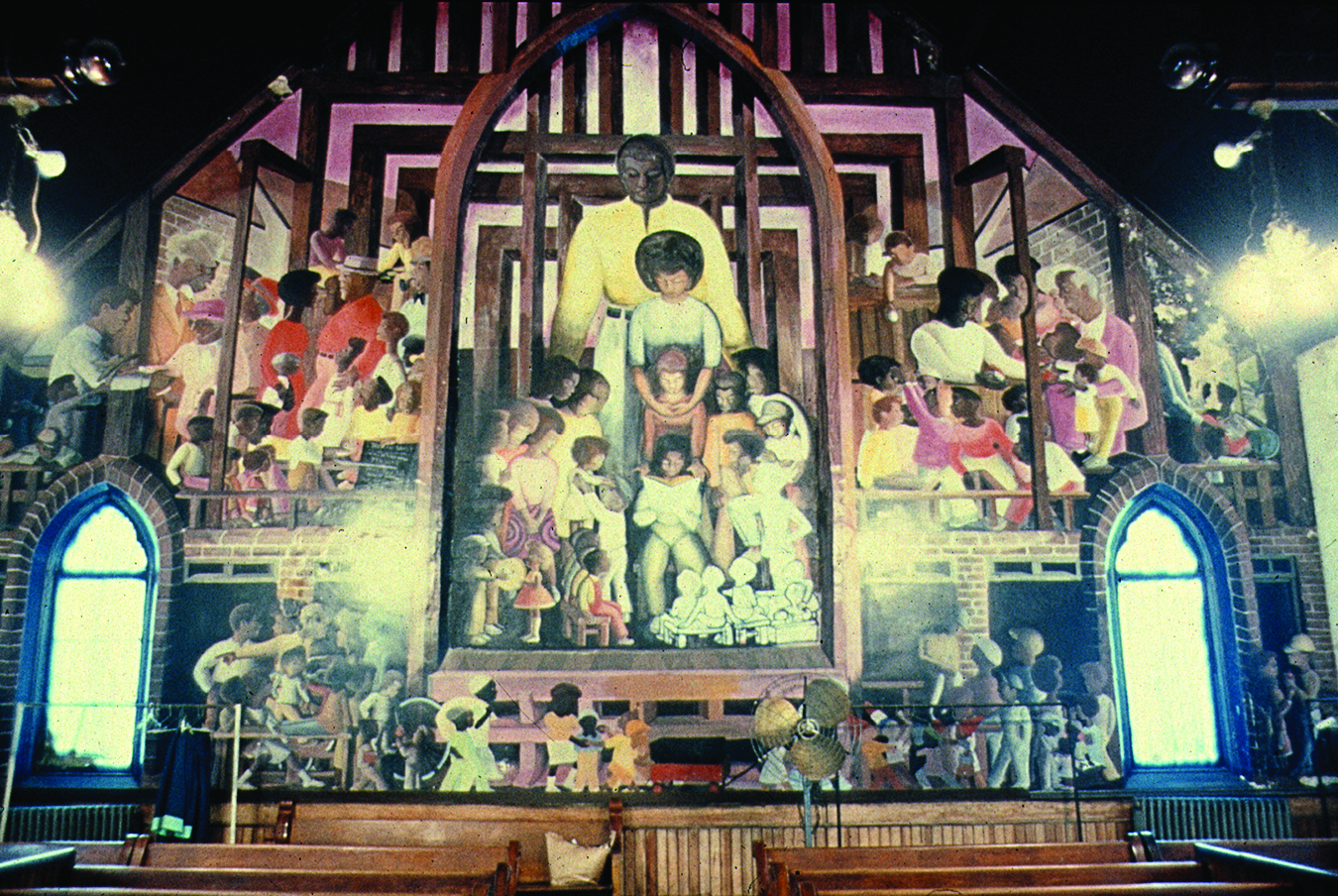 """""""All of Mankind: The Unity of the Human Race,"""" created from 1971 to 1973, an interior view of the mural at the old Stranger's Home Missionary Baptist Church, 617 W. Evergreen Ave. Artist William Walker covered the sanctuary of the former San Marcello Miss"""