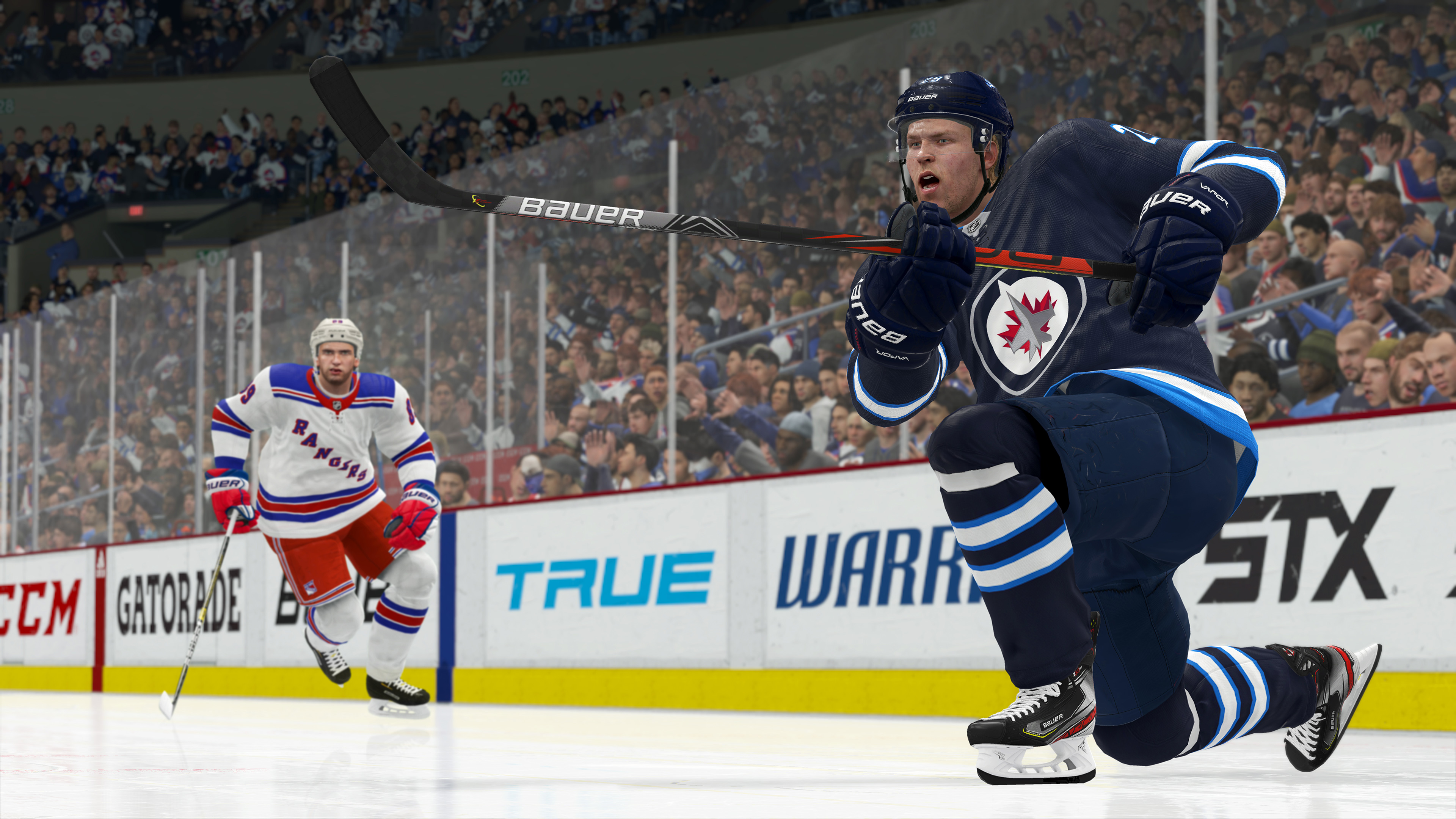 NHL 20 screenshot of the Winnipeg Jets' Patrik Laine on one knee, having just taken a shot, with the New York Rangers' Pavel Buchnevich in the background