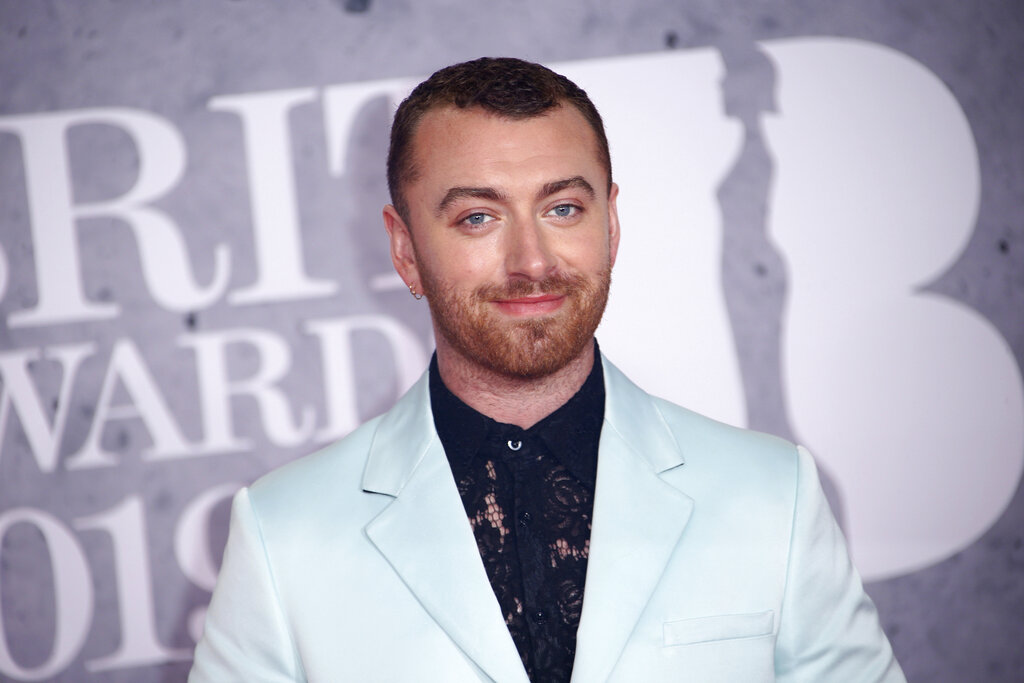 Sam Smith posing for photographers upon arrival at the Brit Awards in London.