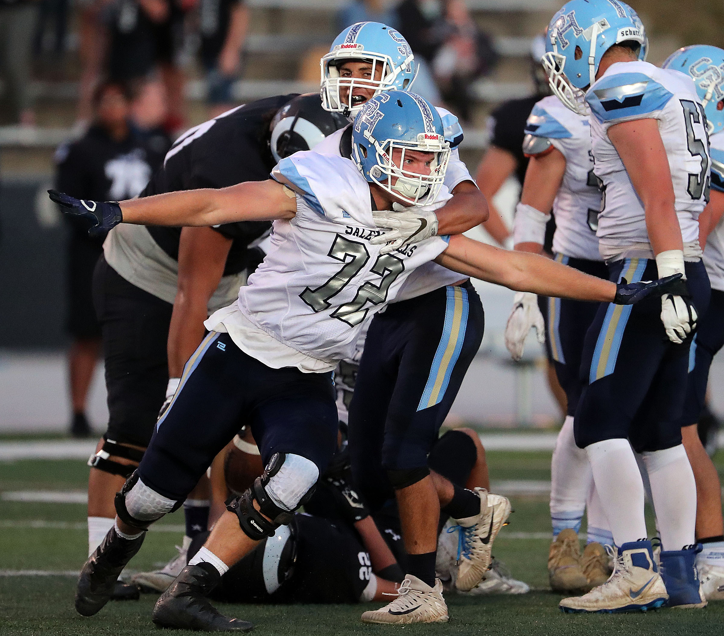 Derek Burton of Salem Hills celebrates making a stop against Highland during a high school football game played in Salt Lake City on Friday, Sept. 13, 2019.