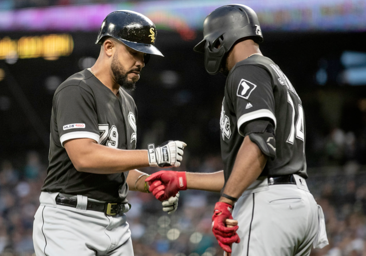Jose Abreu (left) is congratulated by Eloy Jimenez after hitting a solo home run in the first inning on Friday in Seattle.