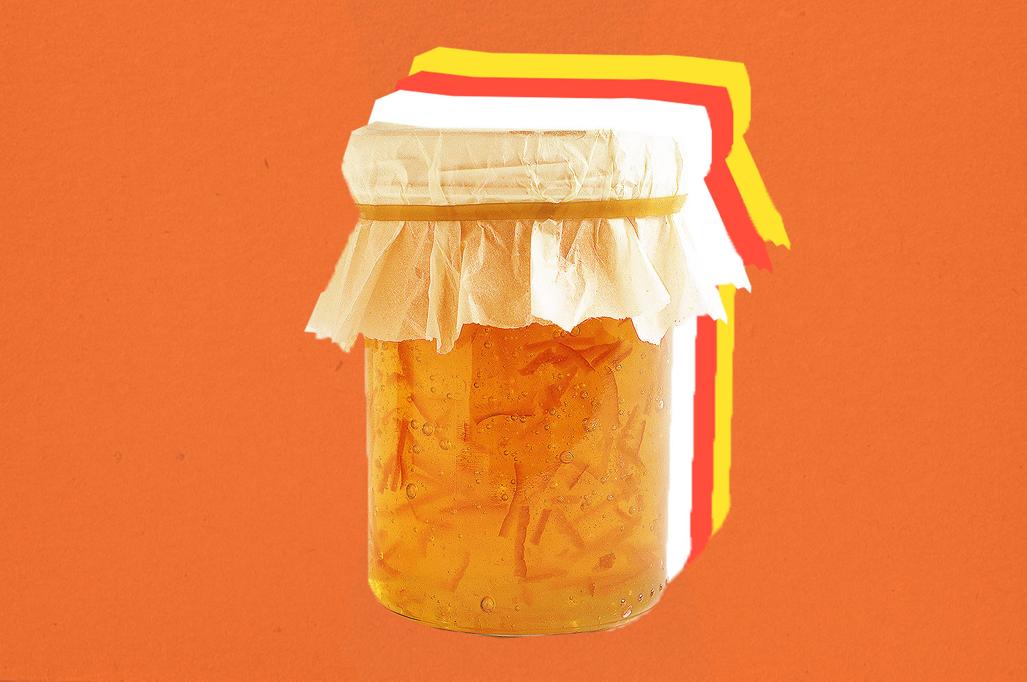 A jar of marmalade on an orange background