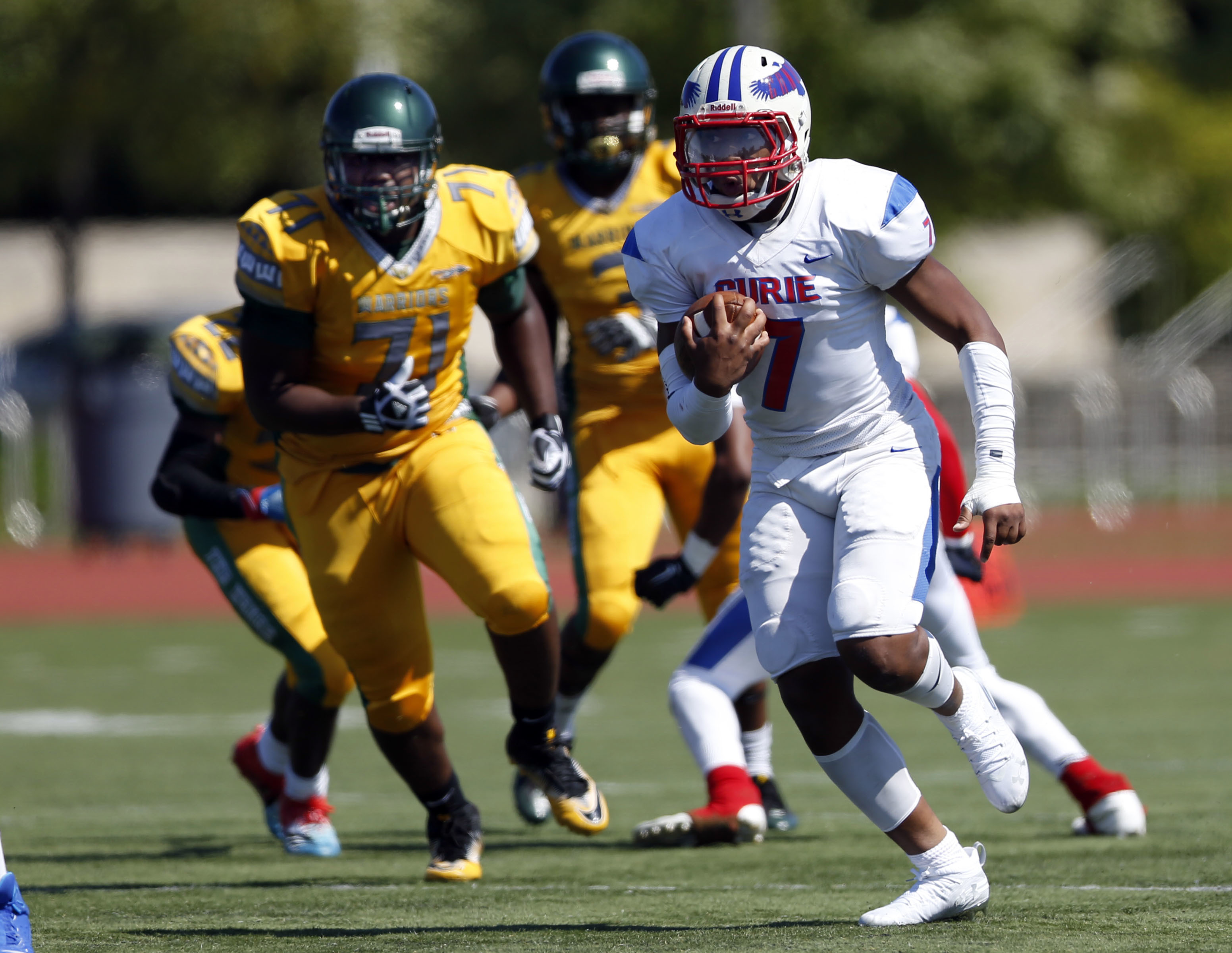 Curie's Damarius Johns (7) finds running room against Westinghouse.