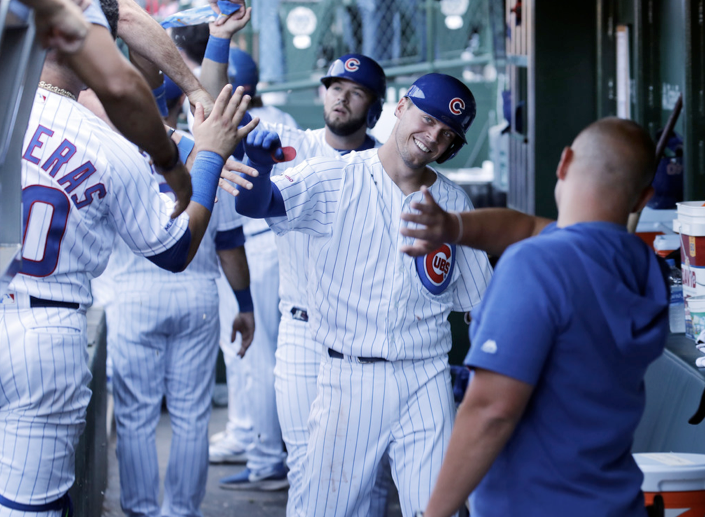 Nico Hoerner is congratulated by teammates following his three-run home run during the sixth inning Saturday against the Pirates at Wrigley Field.