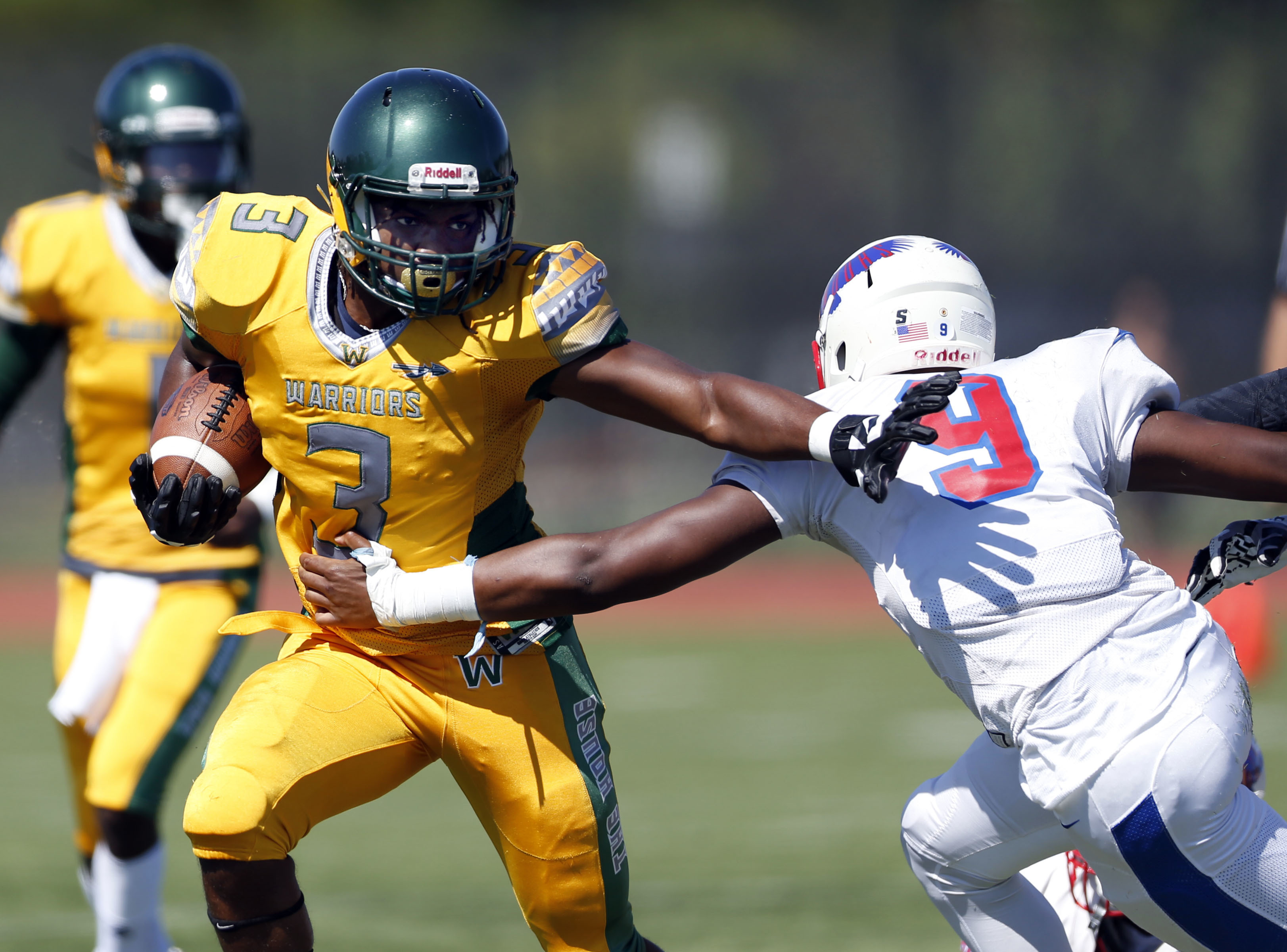 Westinghouse's Rashard Moore (3) holds off Curie's Justin Osburn (9).