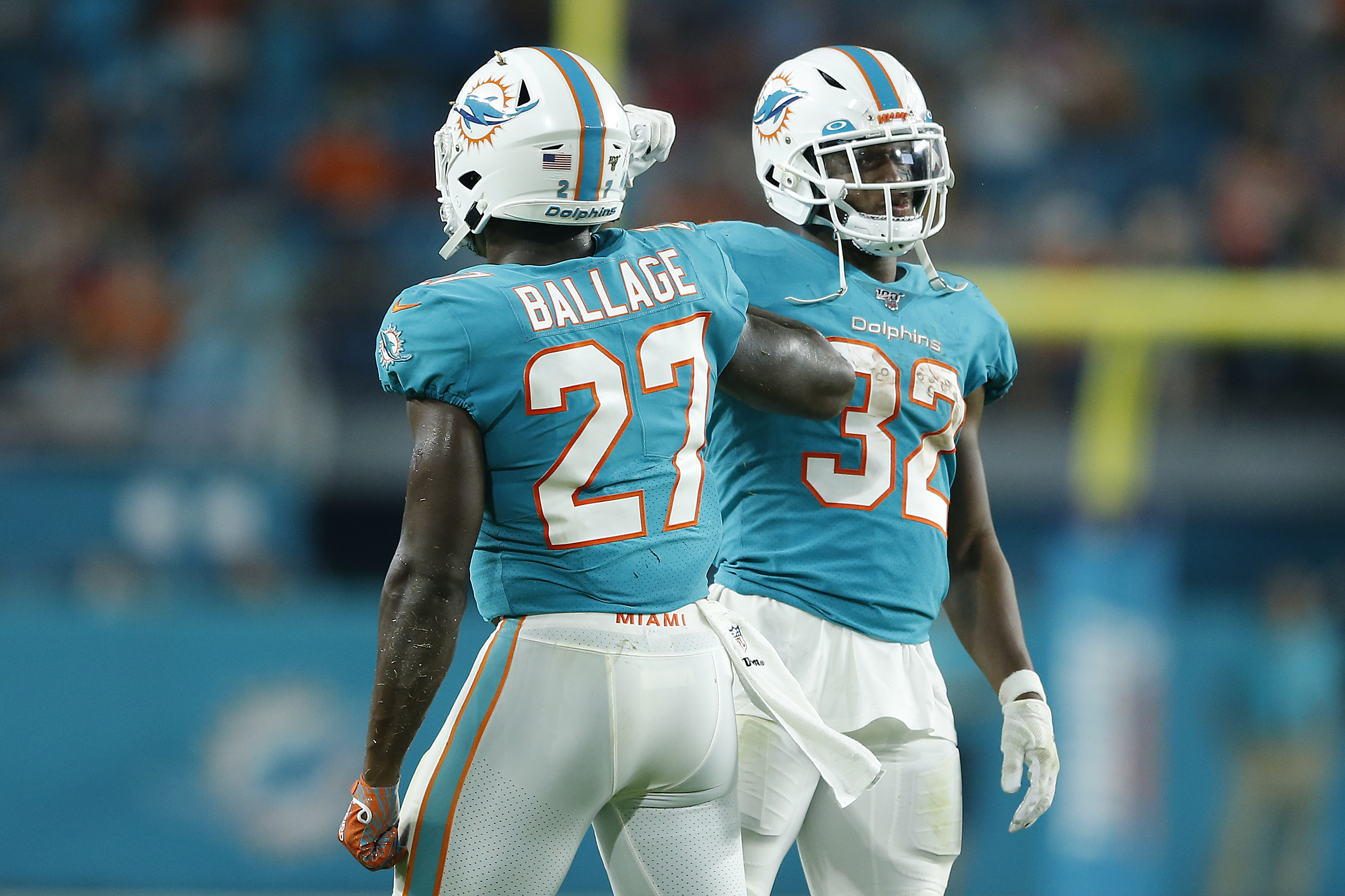 Kalen Ballage of the Miami Dolphins celebrates with Kenyan Drake after scoring a touchdown against the Atlanta Falcons during the first quarter of the preseason game at Hard Rock Stadium on August 08, 2019 in Miami, Florida.