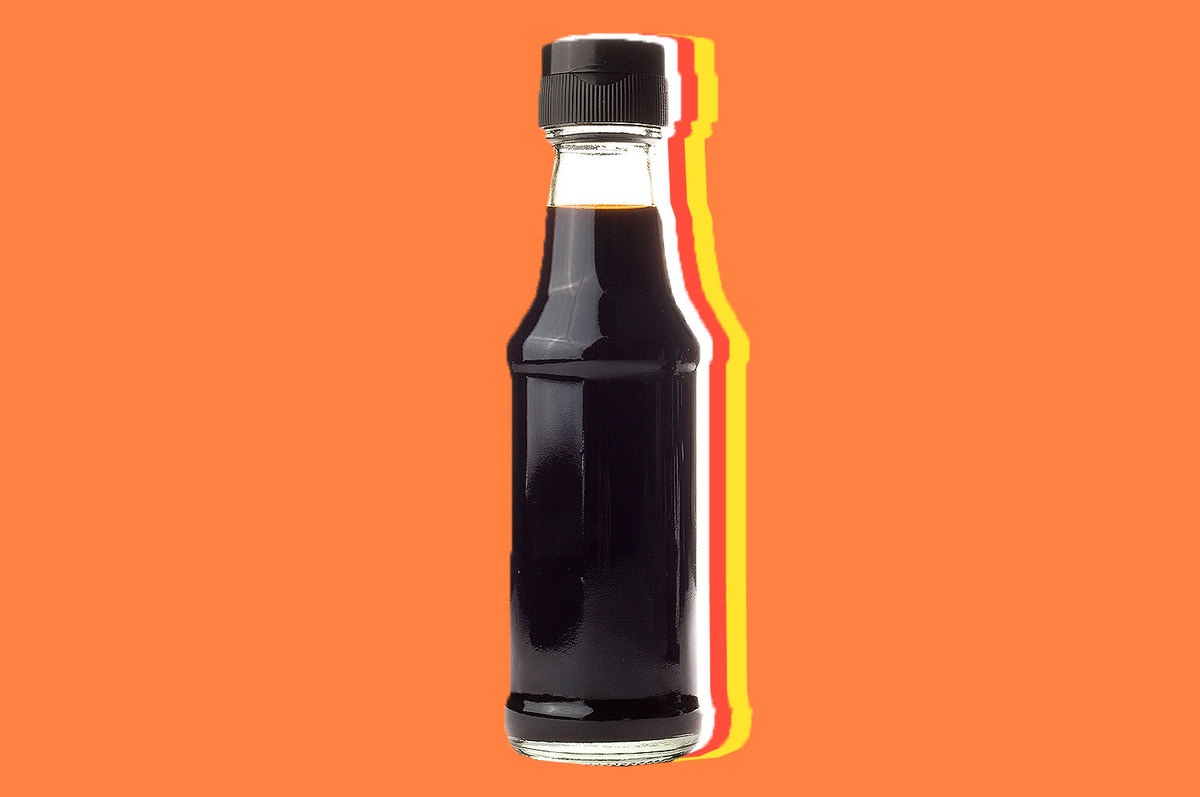 A bottle of soy sauce with no label