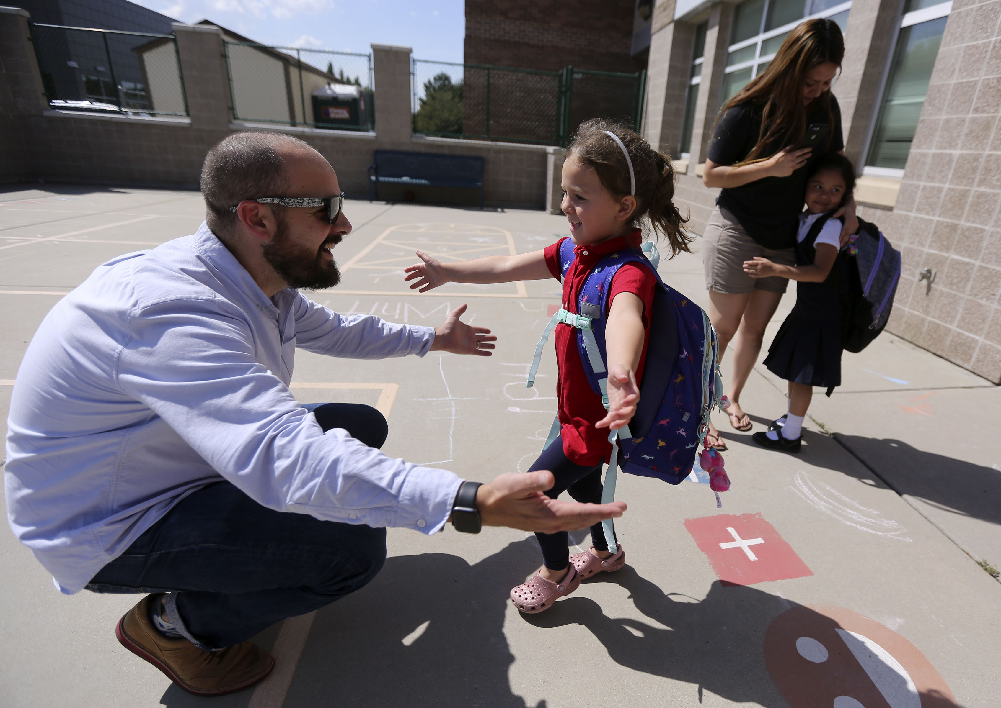 Chris Conard picks up his daughter Hazel Conard from kindergarten at Whittier Elementary School in Salt Lake City before dropping her off at Makiko's Daycare Center in Murray on Thursday, Sept. 5, 2019.