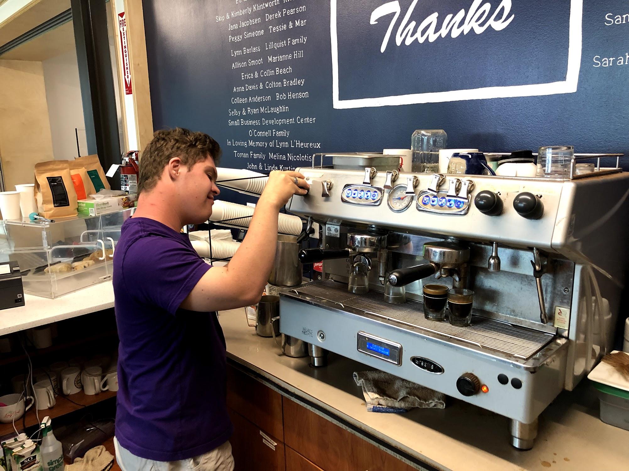 Lucky Ones team member Cole Jones prepares a latte.