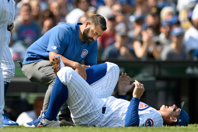 Anthony Rizzo is tended to after spraining his ankle during the third inning Sunday against the Pirates at Wrigley Field.