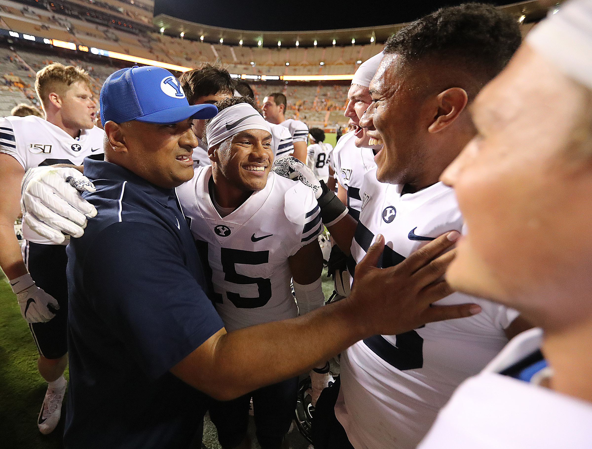Head coach Kalani Sitake and his players celebrate their win over Tennessee in Knoxville on Saturday, Sept. 7, 2019. BYU won 29-26 in double overtime.