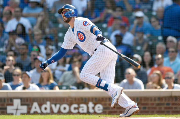 Kris Bryant watches his three-run home run during the first inning Sunday against the Pirates at Wrigley Field.